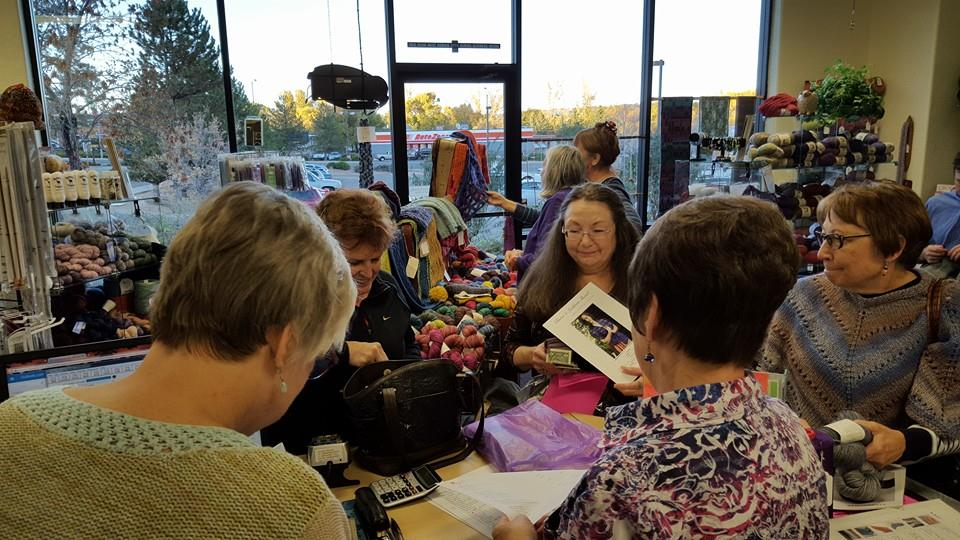 Shoppers at an Anzula trunk show at  Fiber Cree k.