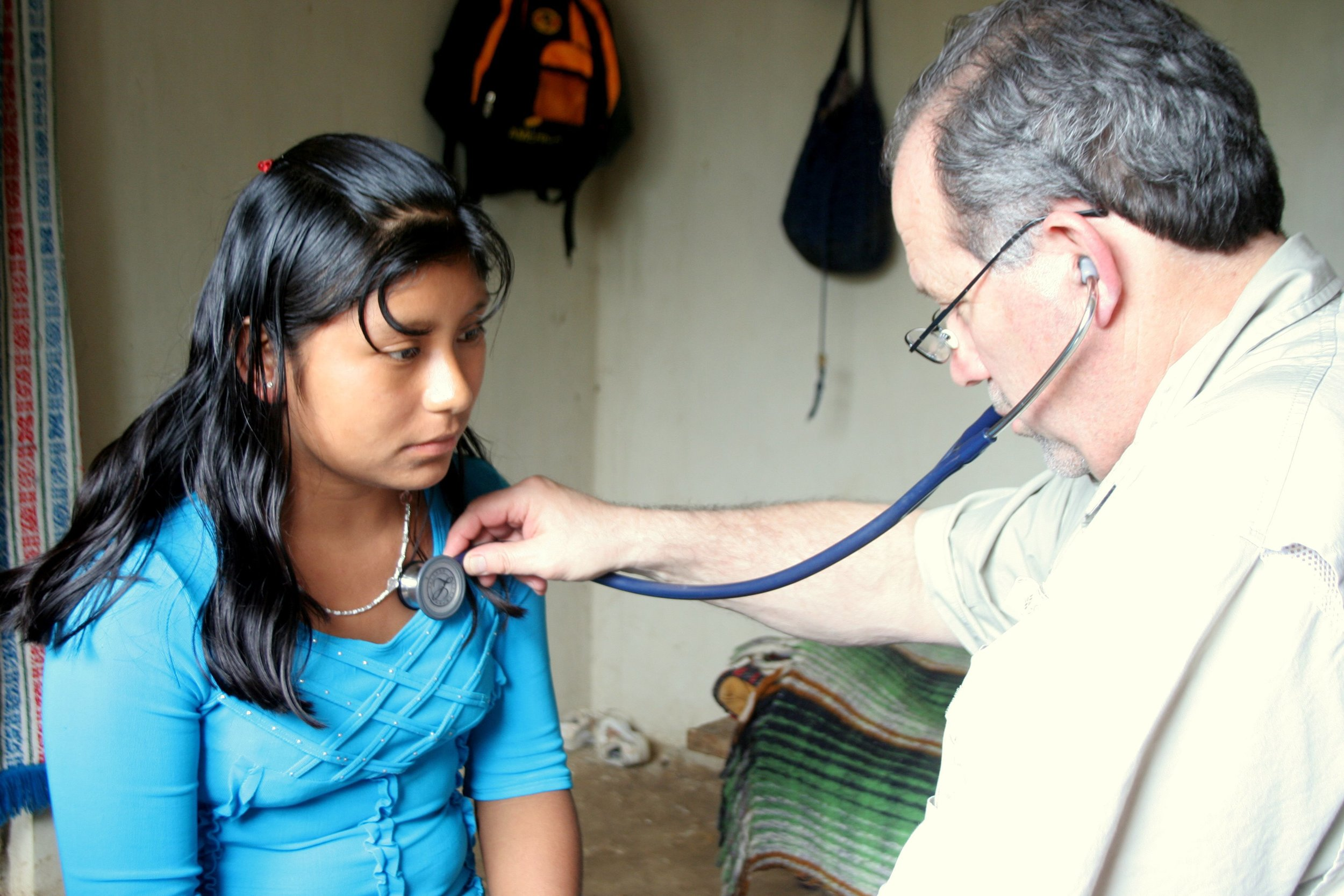 Dr. Richard Young giving medical care
