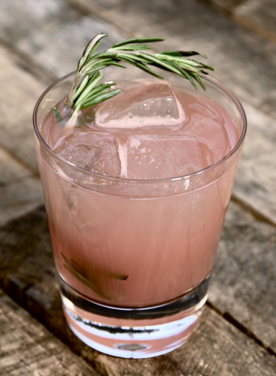 1 1/2 oz Gin  1 oz Chareau  1 oz Watermelon  1/2 oz Fresh Lime Juice  1/2 oz Simple Syrup  Shake Gin, Chareau, Watermelon, Lime juice and Simple Syrup with ice. Strain and pour over ice. Garnish with Fresh Rosemary.