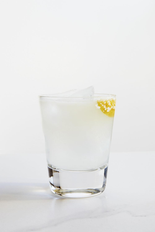 OAXACAN WHISTLE   1 1/2 oz Mezcal  1 oz Chareau  1/2 oz Fresh Lime Juice  1/4 oz Fresh Pineapple Juice  1/2 oz Agave Nectar  Dash of Habanero Bitters  Salt  Shake Mezcal, Chareau,lime, pineapple, and agave nectar with ice. Strain and pour over ice. Garnish with a salt rim on the glass.