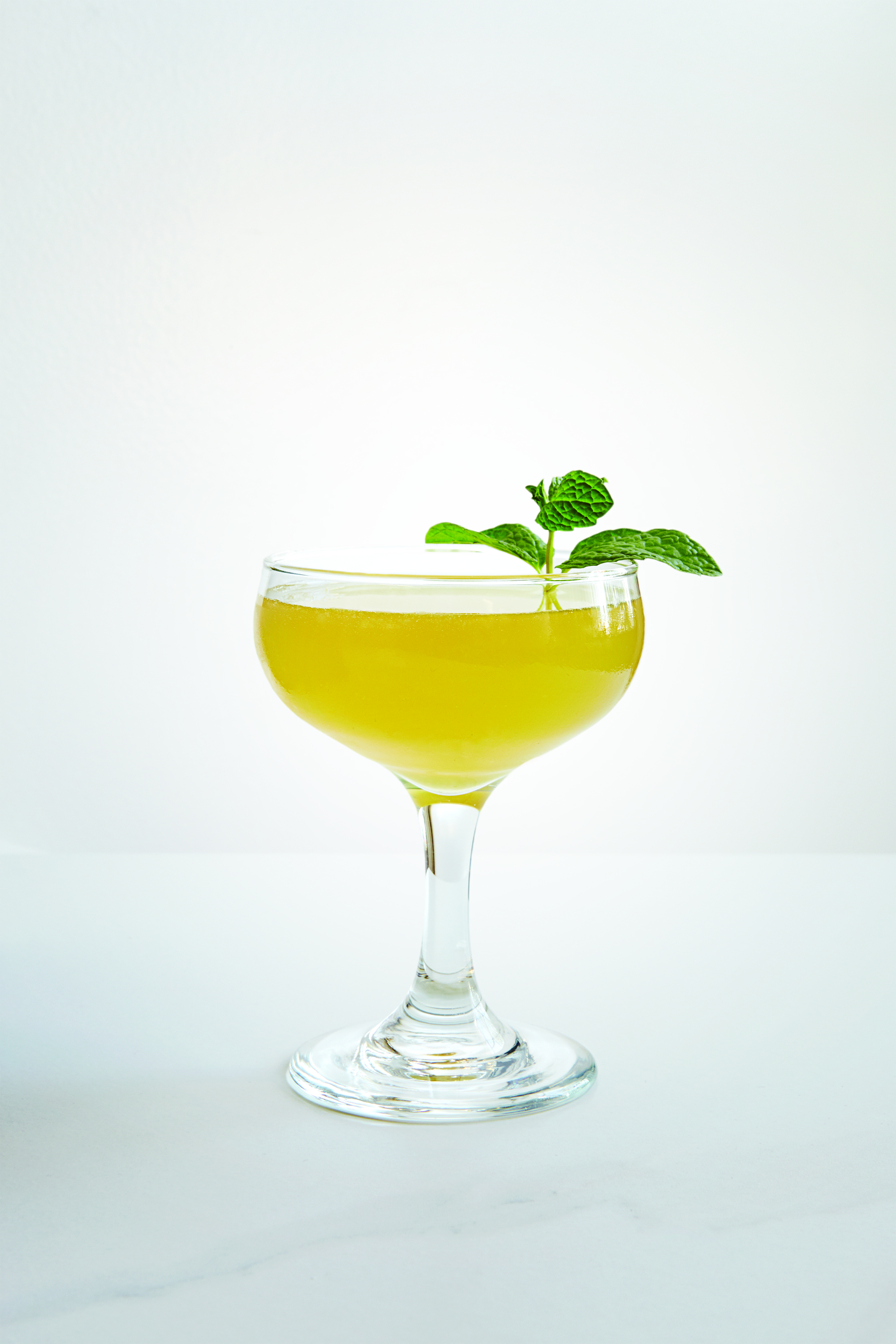 EDIE PARKER   1 1/4 oz Chareau  3/4 oz Pisco  1/2 oz Fresh Lime Juice  1/4 oz Fernet Branca  1/4 oz Simple Syrup  2 Slices Cucumber  Press 2 slices of cucumber in shaker. Add all ingredients and shake with ice. Strain into coupe.   Cocktail by Chris Amirault