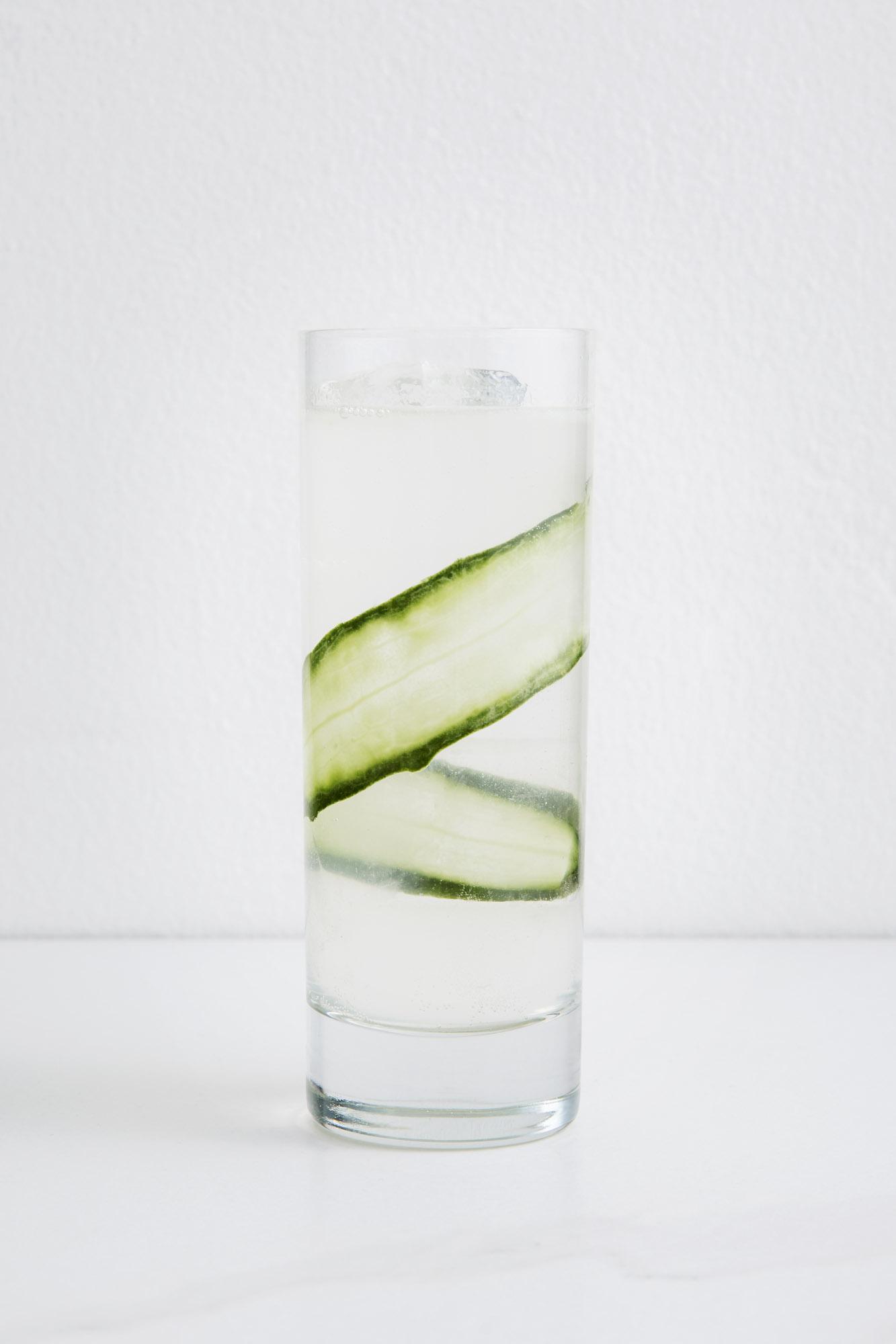 SPA COCKTAIL   1 1/2 oz Vodka  1 oz Chareau  1 ozFresh Lemon Juice  1/4 oz Simple Syrup  Soda  Shake Vodka, Chareau, lemon juice, and simple syrup with ice. Strain and pour over ice. Top with soda and garnish with fresh Cucumber.
