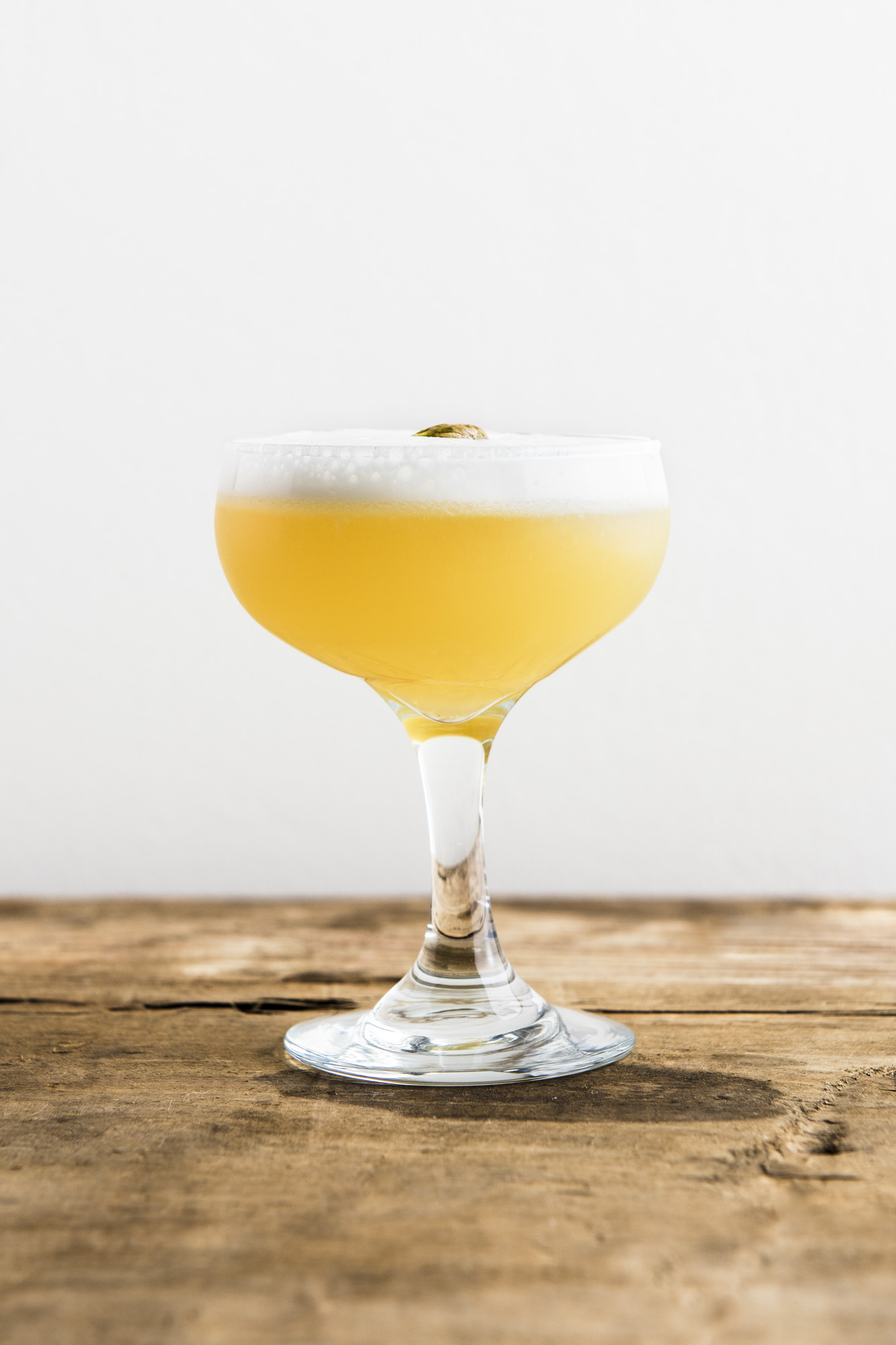 SAN SIMEON   1 1/2 oz Mezcal  1/2 oz Chareau  3/4 oz Fresh Lemon Juice  1/4 oz Light Agave Syrup  1 Egg White  Dry shake all ingredients without ice. Add ice and shake again. Pour into coupe and garnish with a pistachio.