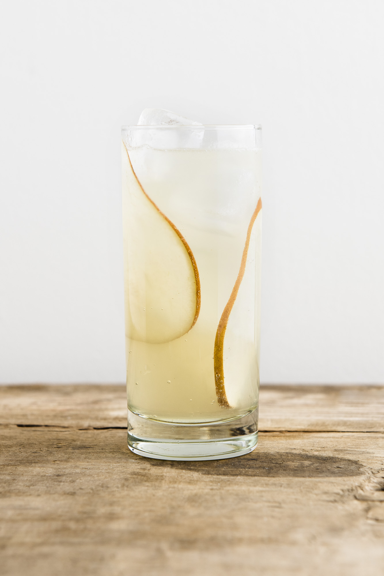 VIHUELA   1 1/2 oz Tequila  1/2 oz Chareau  3/4 oz Fresh Lime Juice  1/4 oz Honey Syrup  2 oz Ginger Beer  Add Chareau, tequila, lime juice, and honey to collins glass filled with ice. Top with Ginger Beer and garnish with sliced pears.
