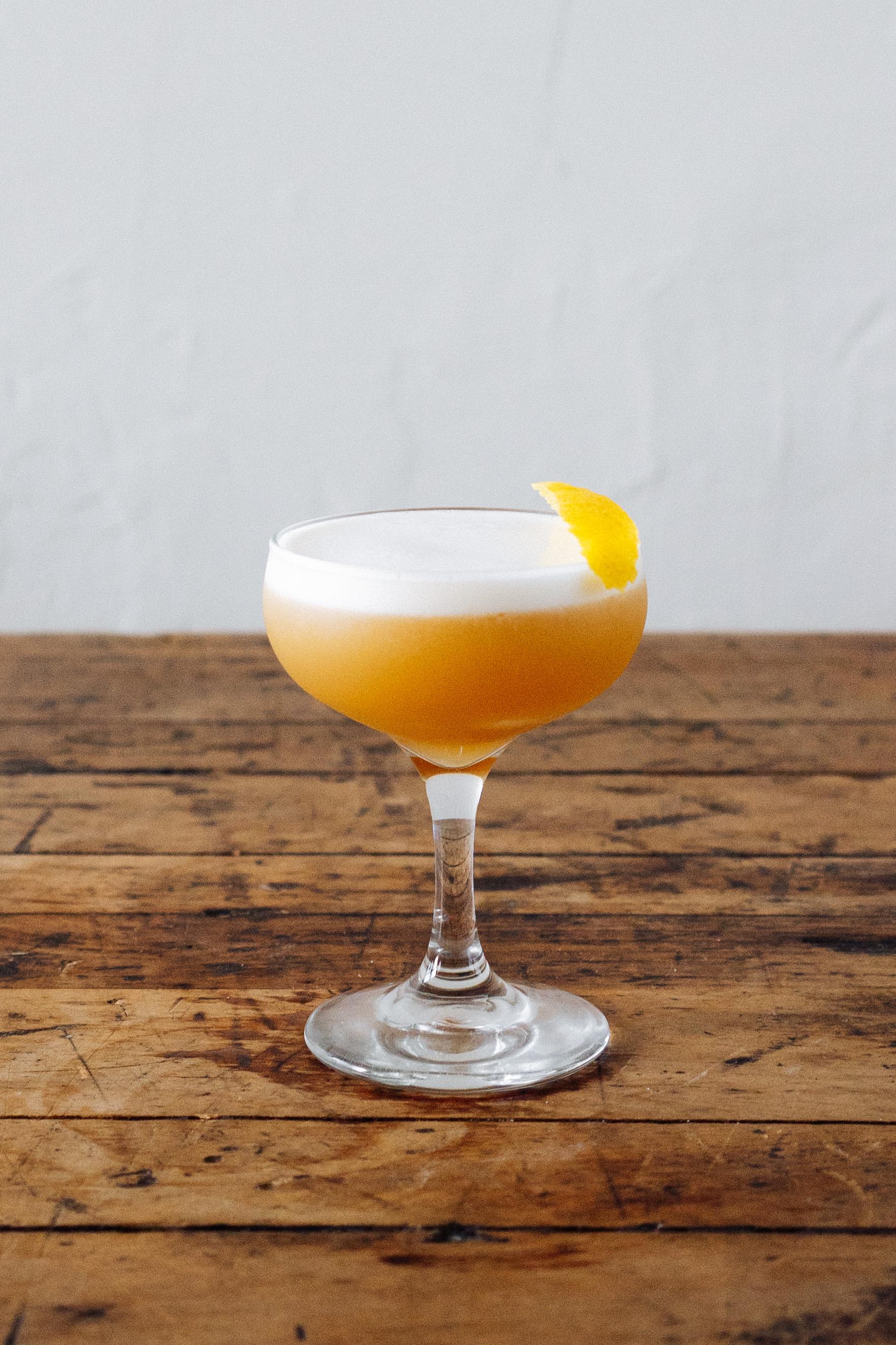MARSHALL GOLD   1 1/2 oz Double Oak Bourbon  1/2 oz Chareau  3/4 oz Lemon Juice  1/2 oz Simple  1 Egg White  Build in tin, dry shake, wet shake, and double strain. Garnish with lemon peel.