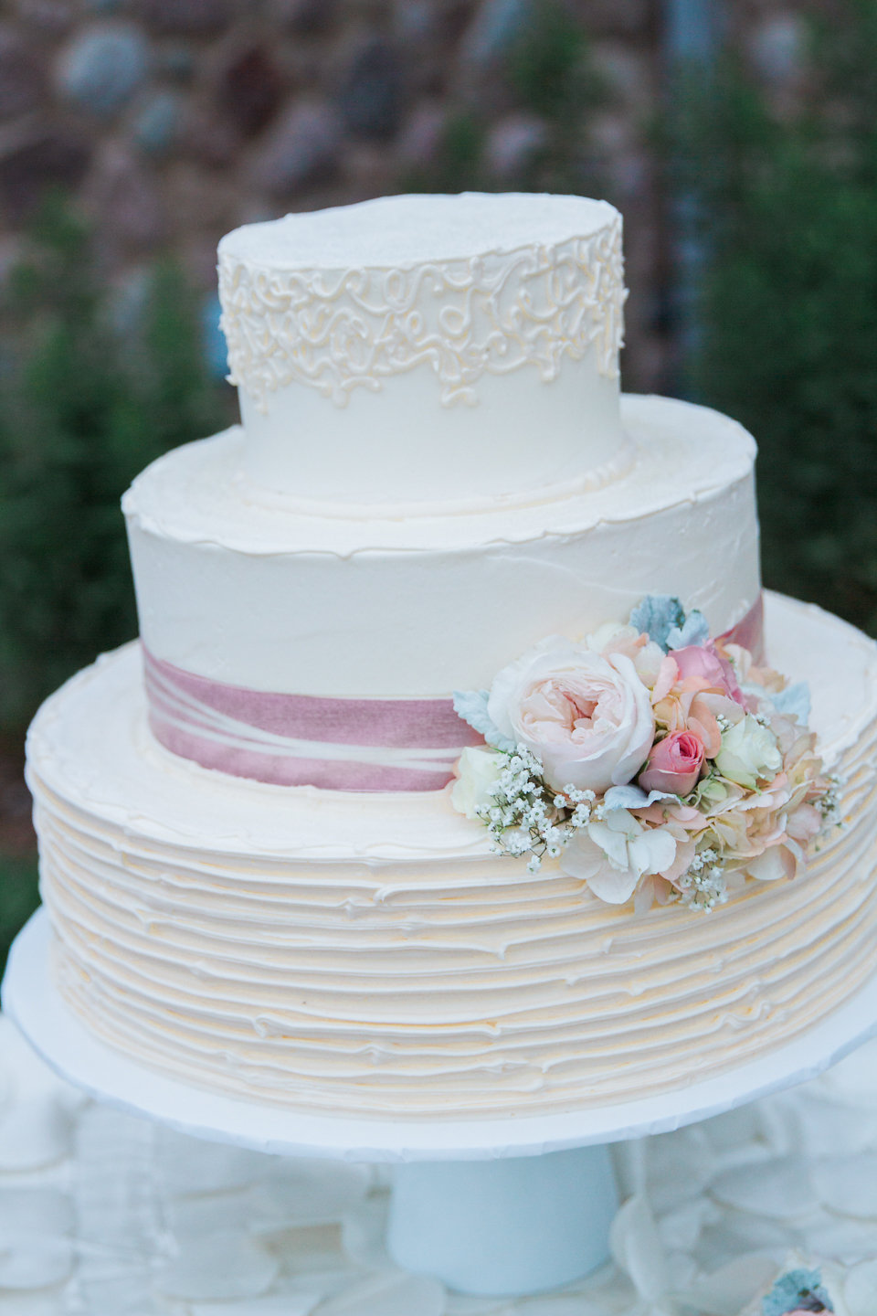 Ivory and blush buttercream wedding cake
