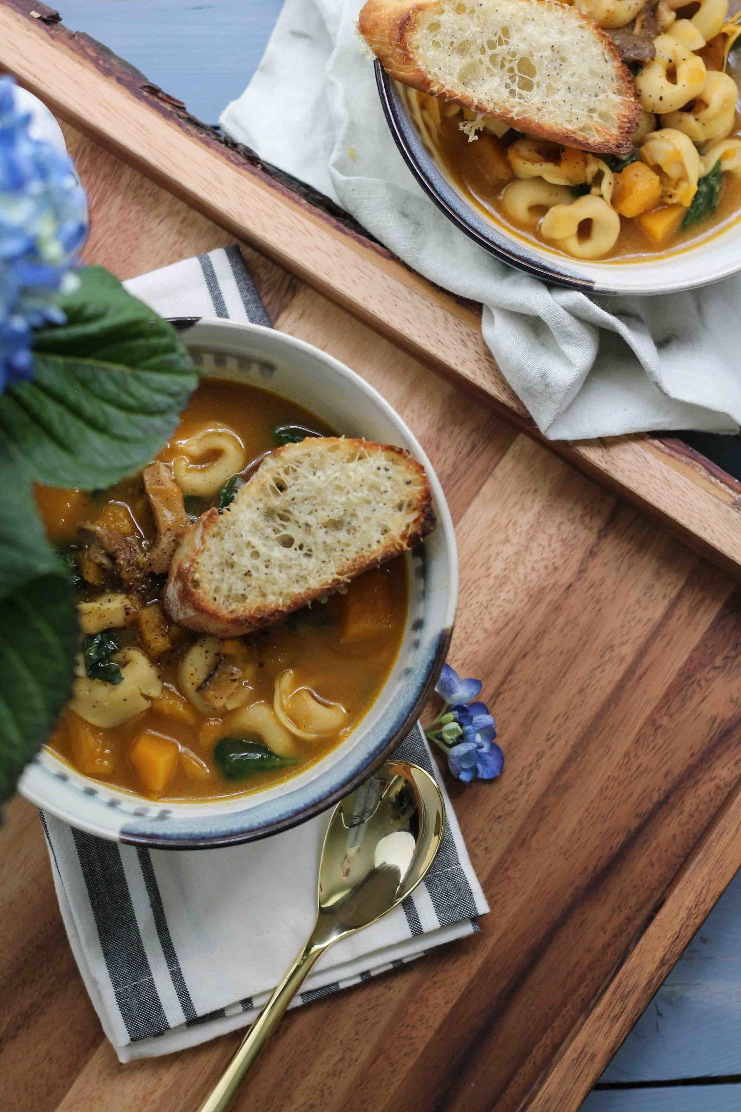 This deliciously hearty Butternut Tortellini Mushroom Stew is the perfect way to transition from summer to fall.  {Pedantic Foodie}