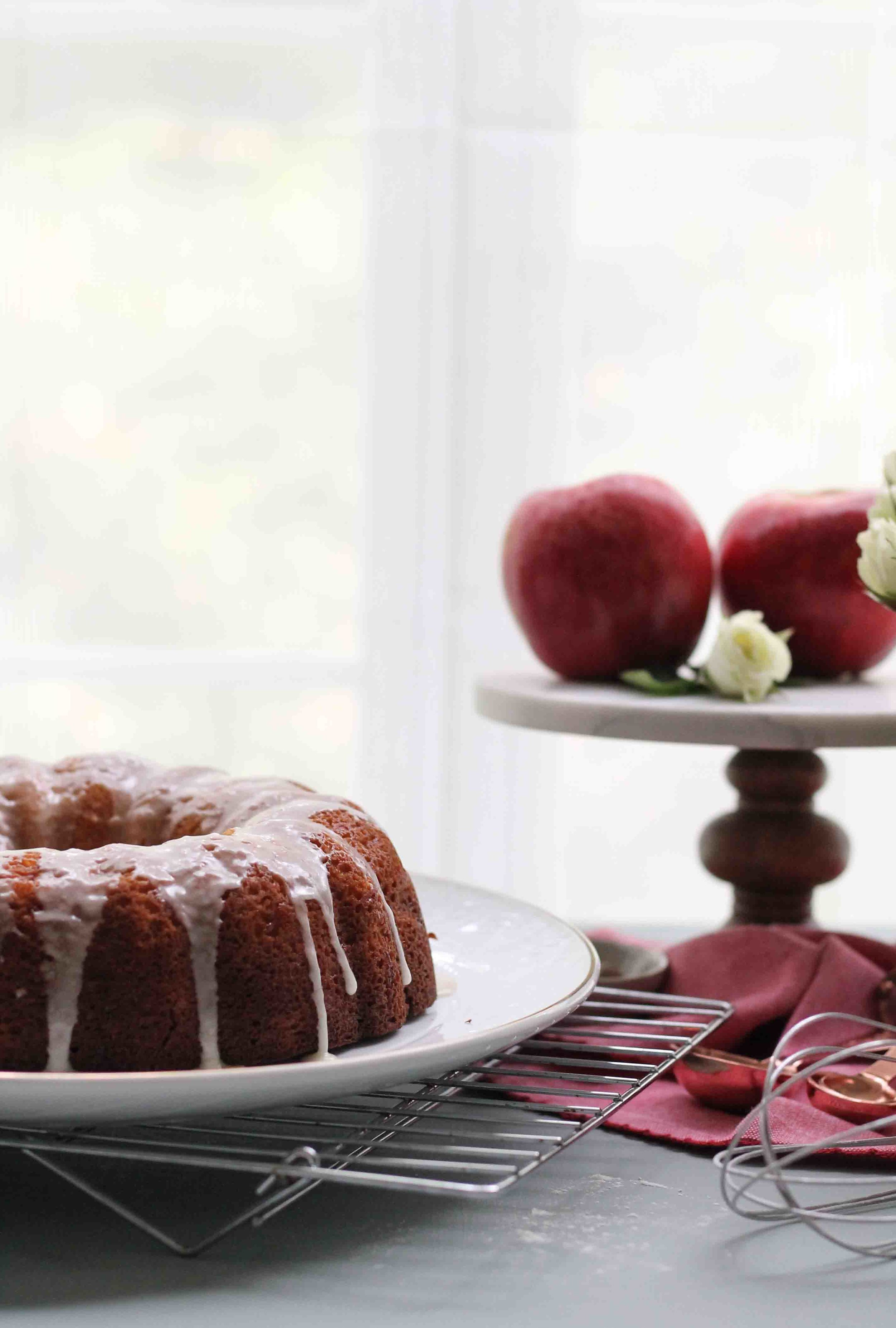 This ultra-moist apple cake is a taste of fall and the perfect quick bake after a long day of apple-picking.  It is studded with sweet, diced apples and drizzled with a tangy cider glaze.  {Pedantic Foodie}