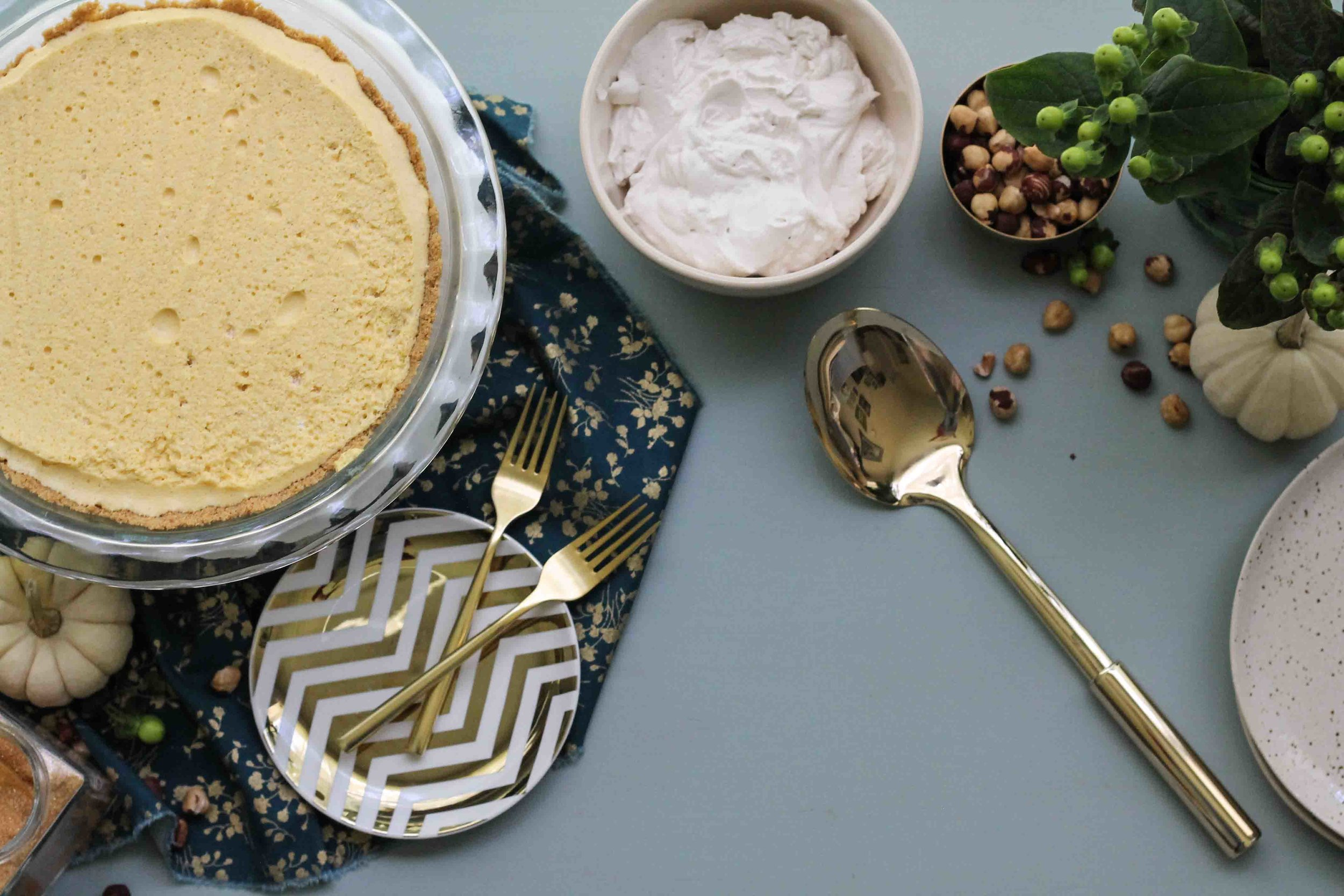 This dreamy pumpkin mousse pie is the perfect way to spice up your Thanksgiving.  Airy pumpkin mousse is topped with a rich, rum and cinnamon whipped cream and crunchy hazelnut brittle.  Your aunt's pumpkin pie has nothing on this. {Pedantic Foodie}