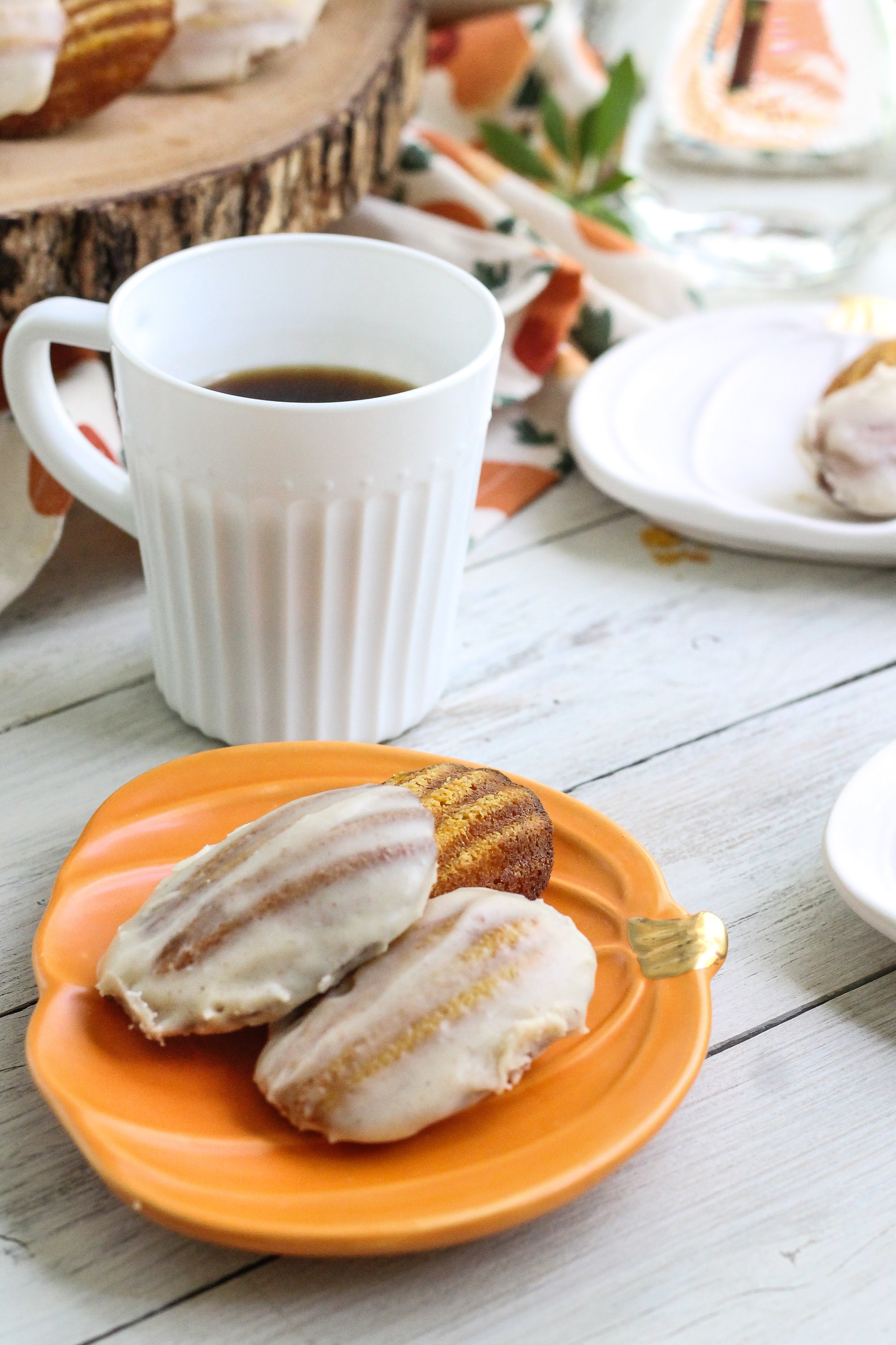 These Spiced Pumpkin Madeleines with Brown Butter Glaze are the perfect accompaniment to your PSL!! [ www.pedanticfoodie.com ]
