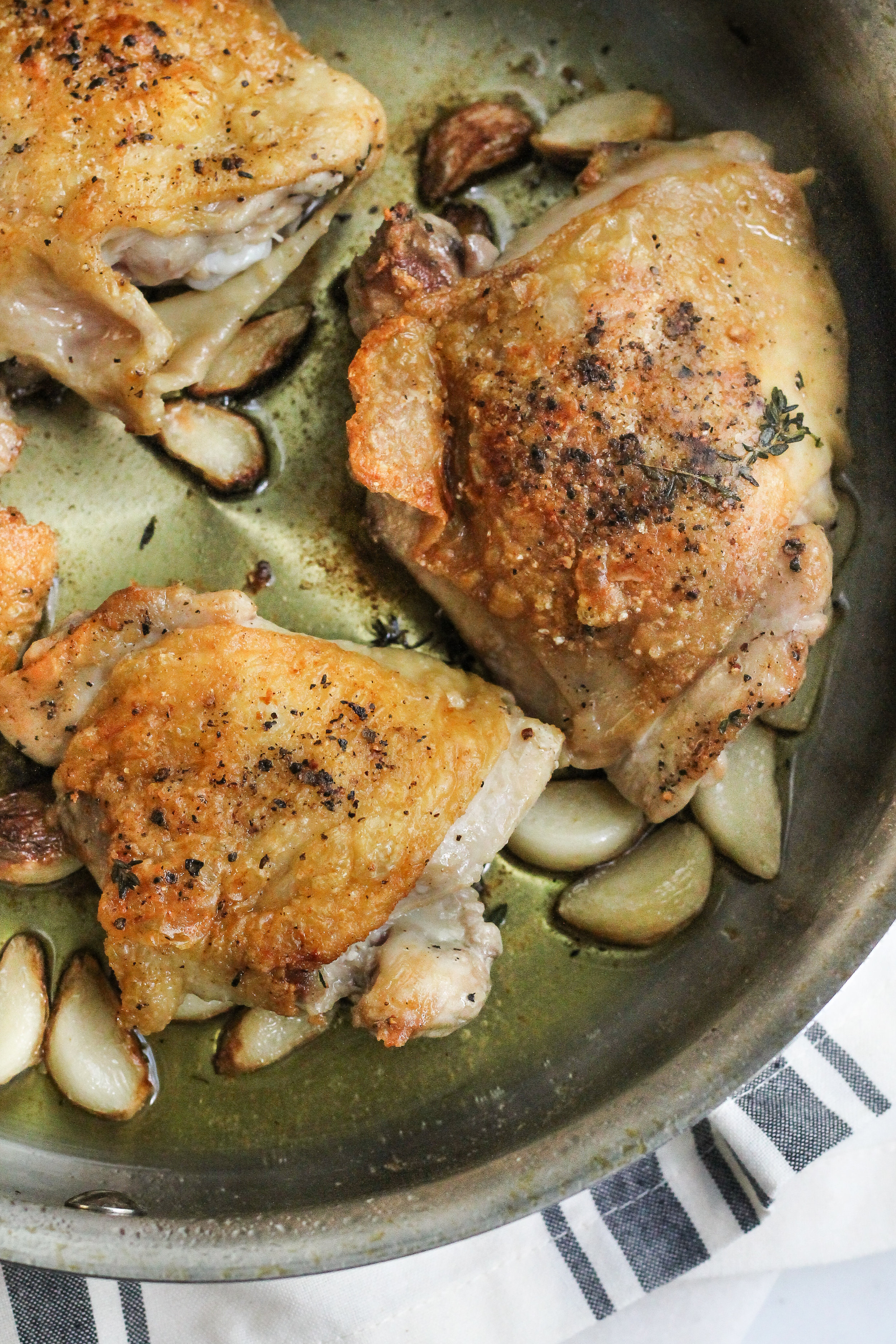 Crispy Garlic Chicken Thighs with Pan Gravy are the perfect weeknight meal for these cool, autumn nights.  [ www.pedanticfoodie.com ]