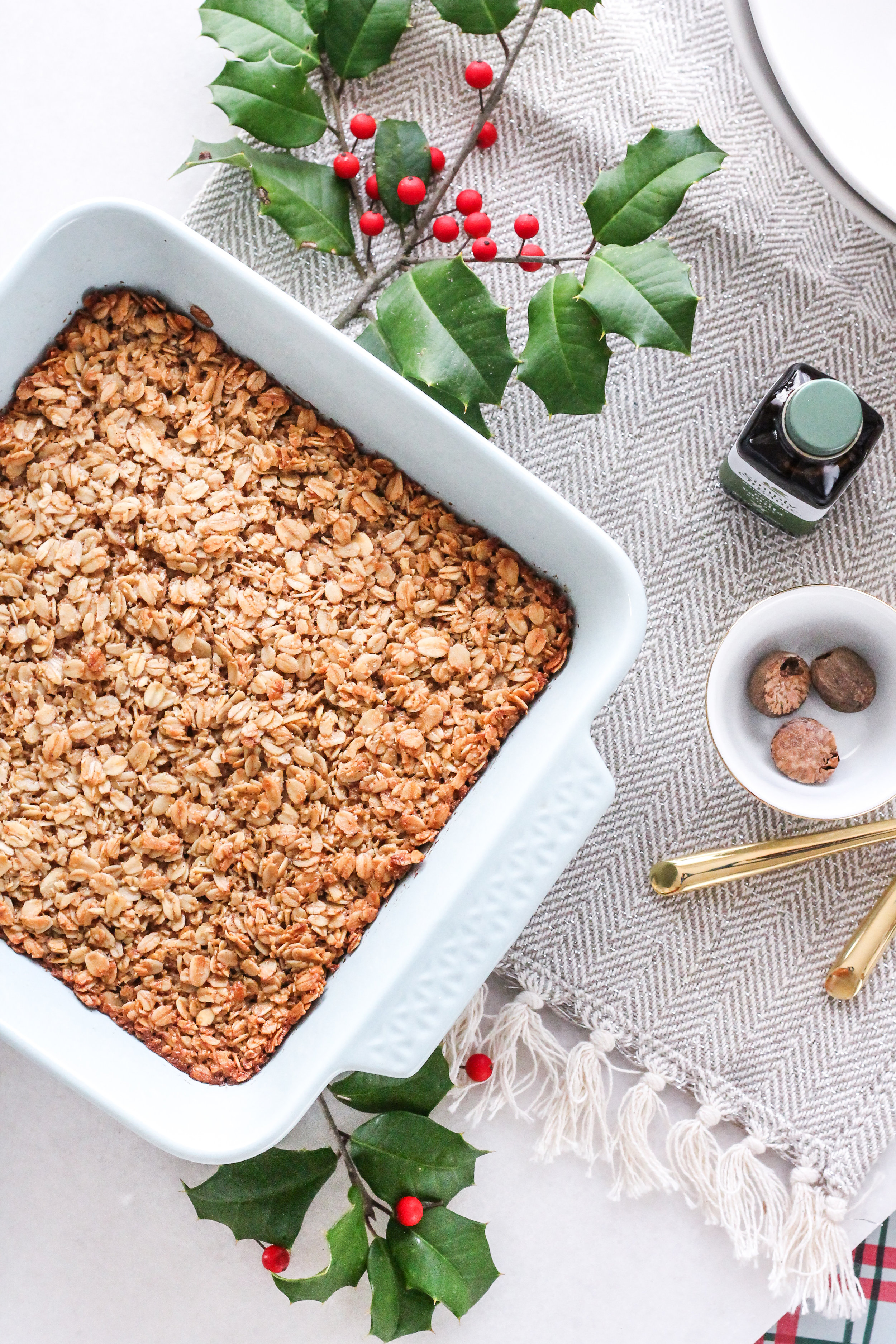 BAKED OATMEAL WITH EGGNOG AND FRESH RASPBERRIES MAKES THE PERFECT CHRISTMAS MORNING BREAKFAST!  FIND THE SUPER SIMPLE RECIPE ON WWW.PEDANTICFOODIE.COM