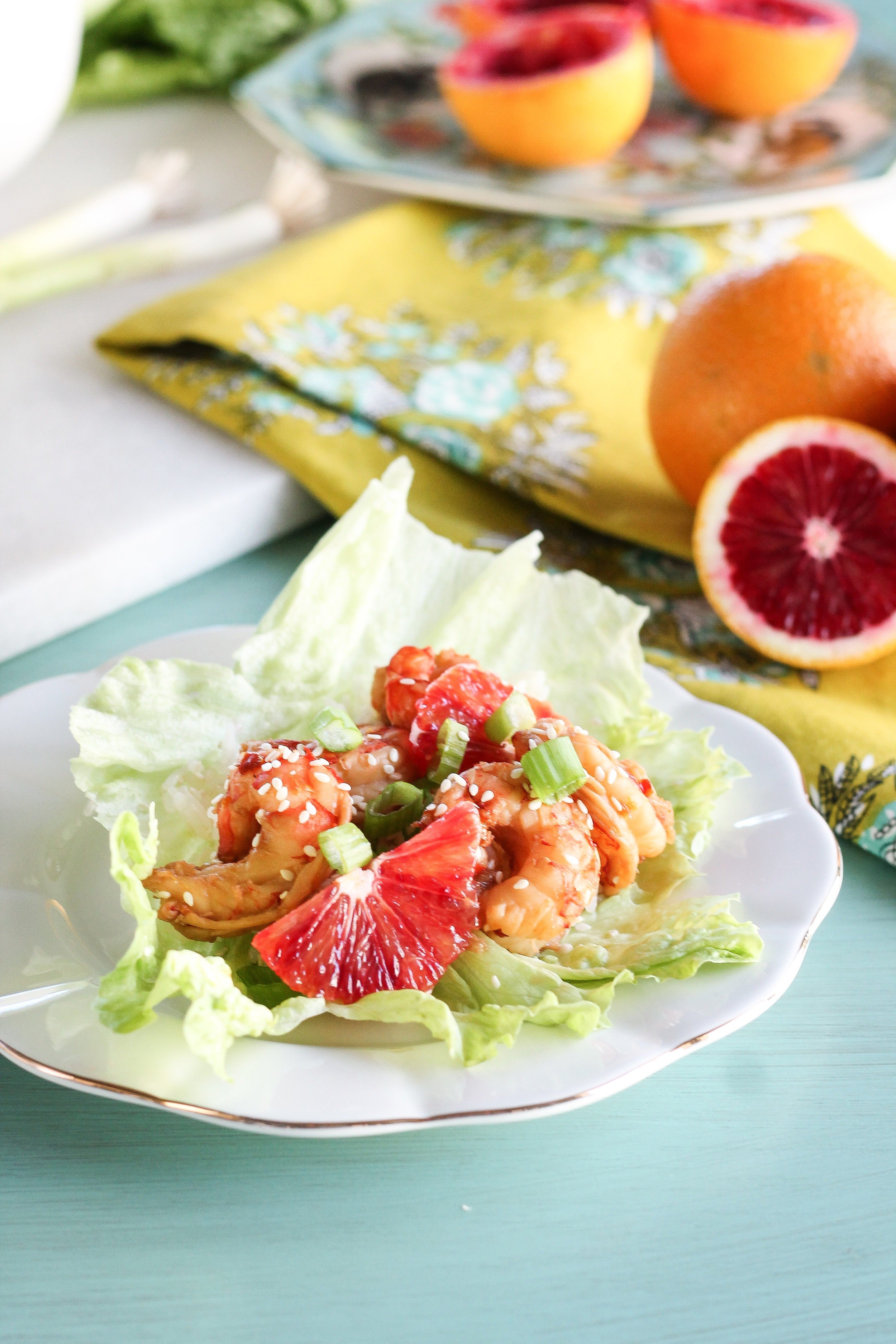 These quick & easy Blood Orange Shrimp & Sesame Marinated Shrimp Lettuce wraps make the perfect, healthy weeknight meal!  Find the recipe at www.pedanticfoodie.com!