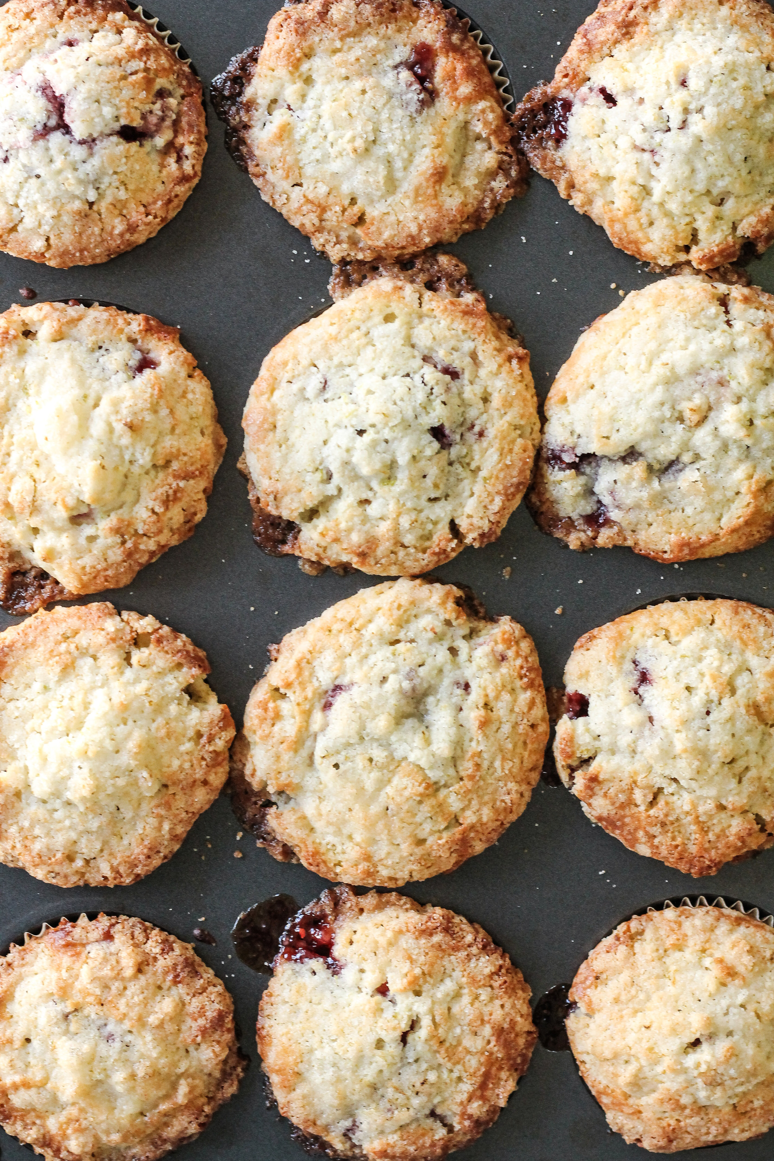 These tender Lime Sugar Streusel Muffins are filled with a tart layer of Raspberry Preserves and covered with a crisp, zesty streusel - a perfect way to start the day!  Find the recipe on www.pedanticfoodie.com!