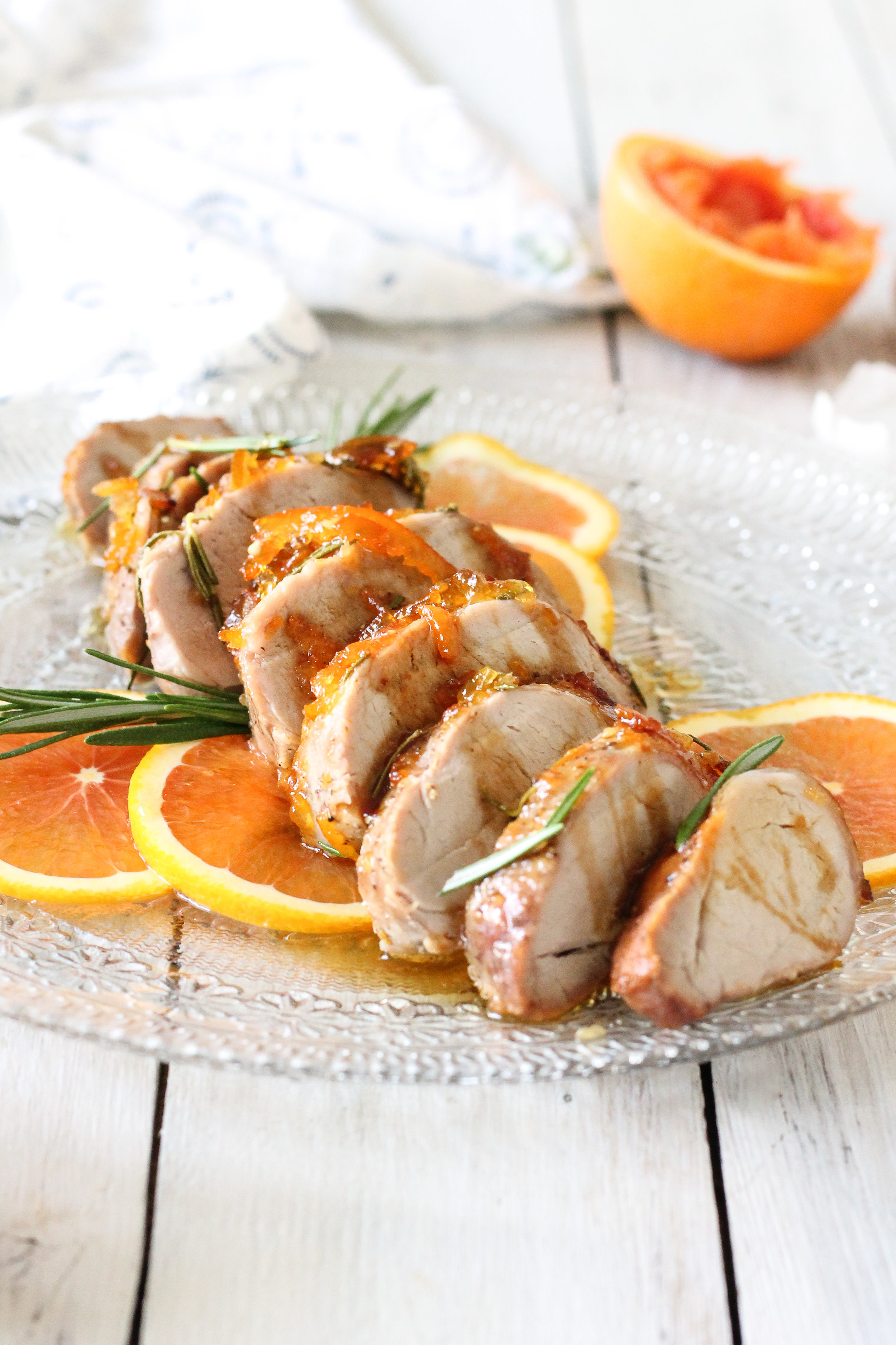 This super easy pork tenderloin is glazed with orange marmalade and rosemary.  Find the recipe on WWW.PEDANTICFOODIE.COM!