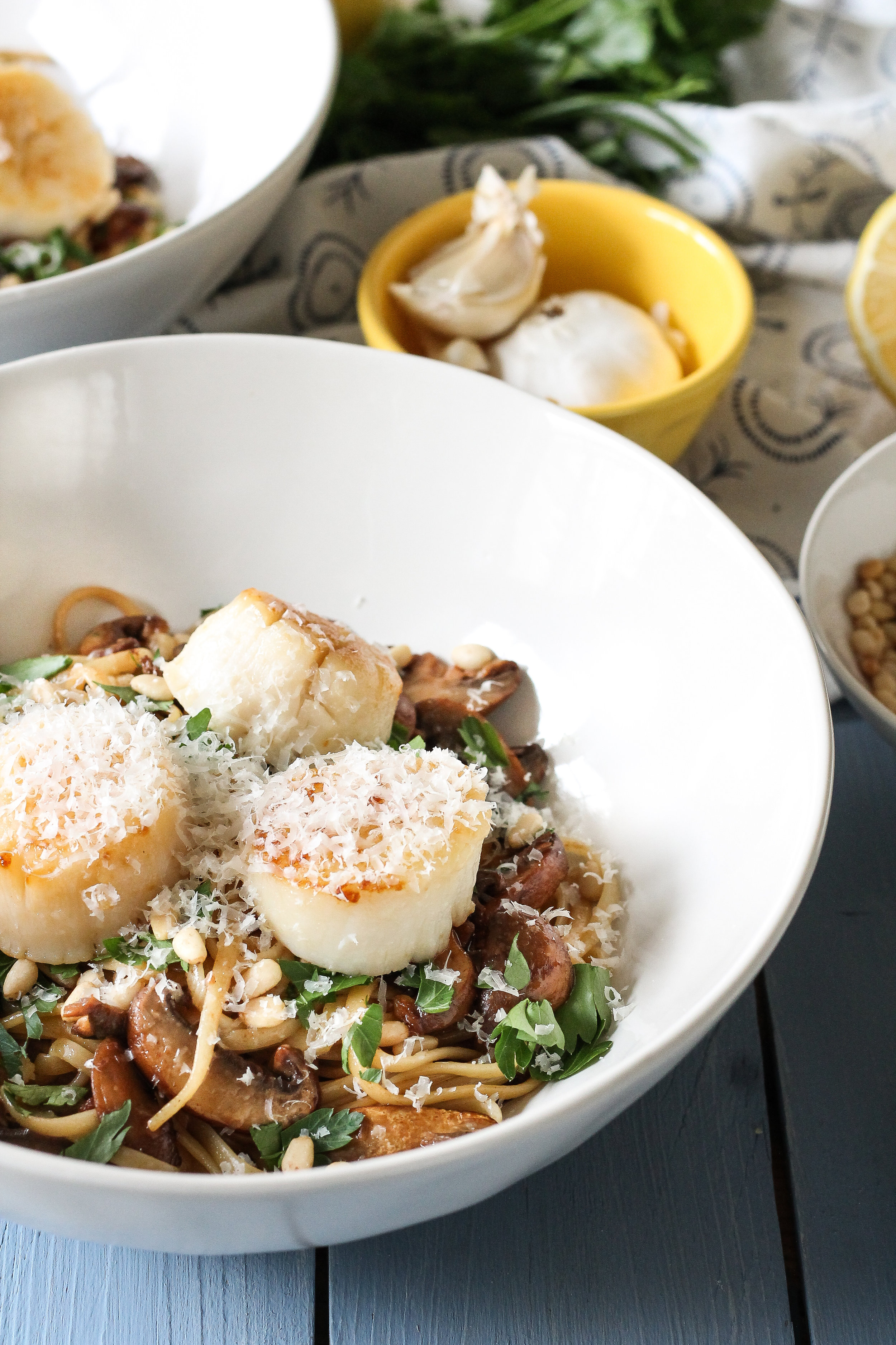 Linguine with Parsley, Mushrooms, Pine Nuts & Scallops makes the perfect date-night dinner at home!  Find the quick and simple recipe at www.pedanticfoodie.com!