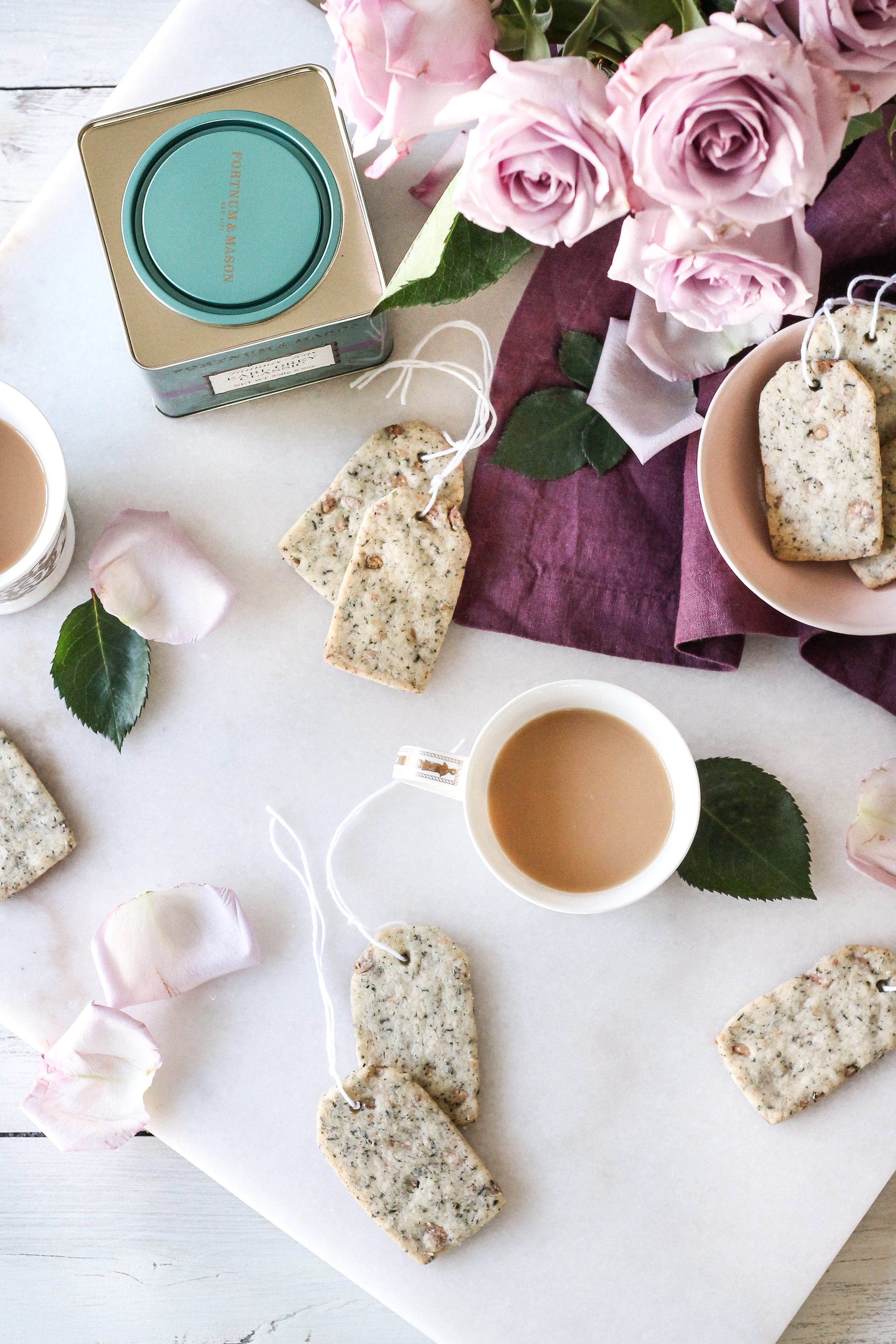 These adorable White Chocolate & Earl Grey Shortbread Tea Cookies make the perfect way to welcome the delicate flavors of spring!  Find the recipe on www.pedanticfoodie.com!