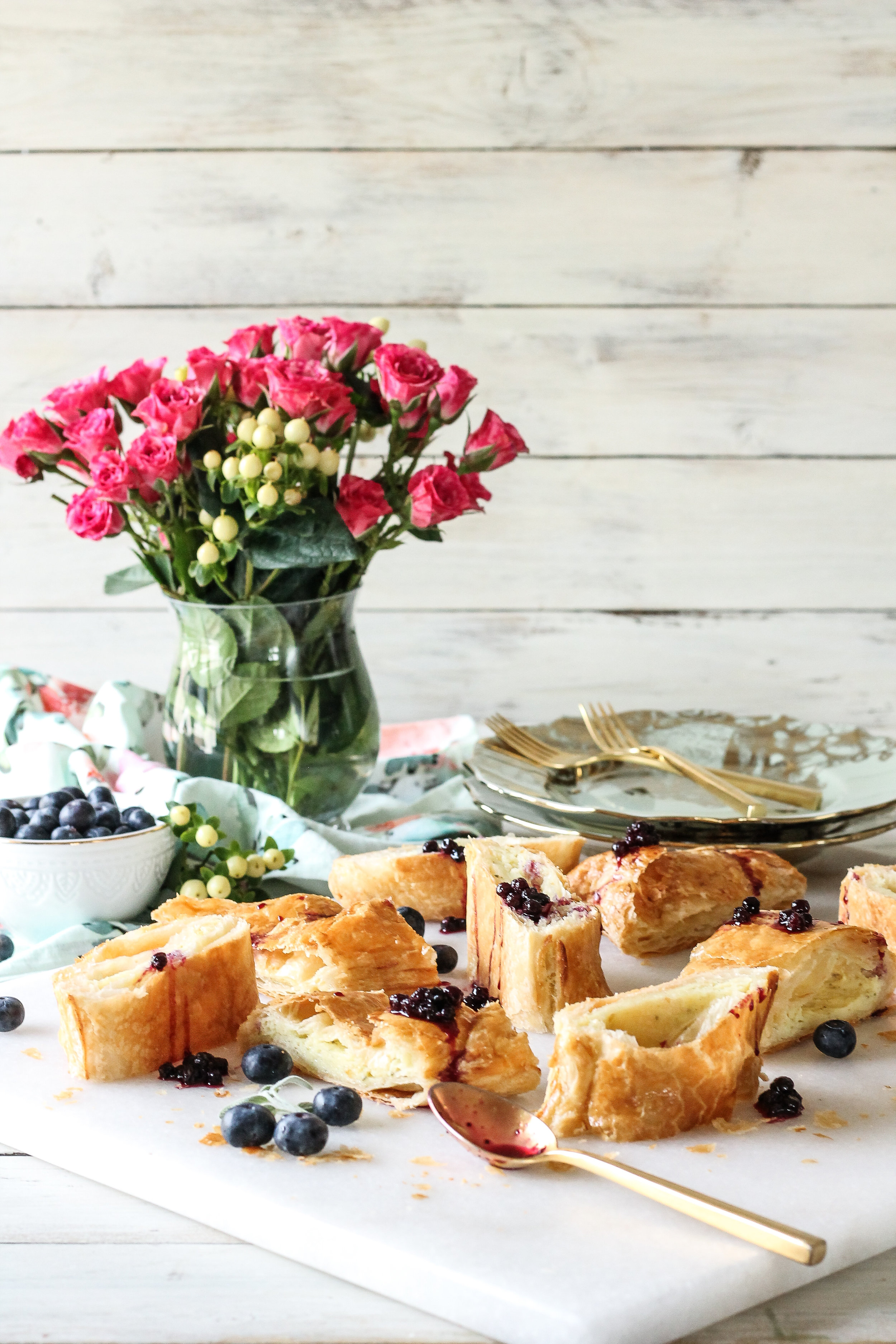 This delicious and simple Easter Bread is sure to be the star of any celebration!  With a delicate vanilla bean and sage mascarpone filling and a wild blueberry sauce, it has all the flavors of spring in every bite!  Find the recipe on www.pedanticfoodie.com!