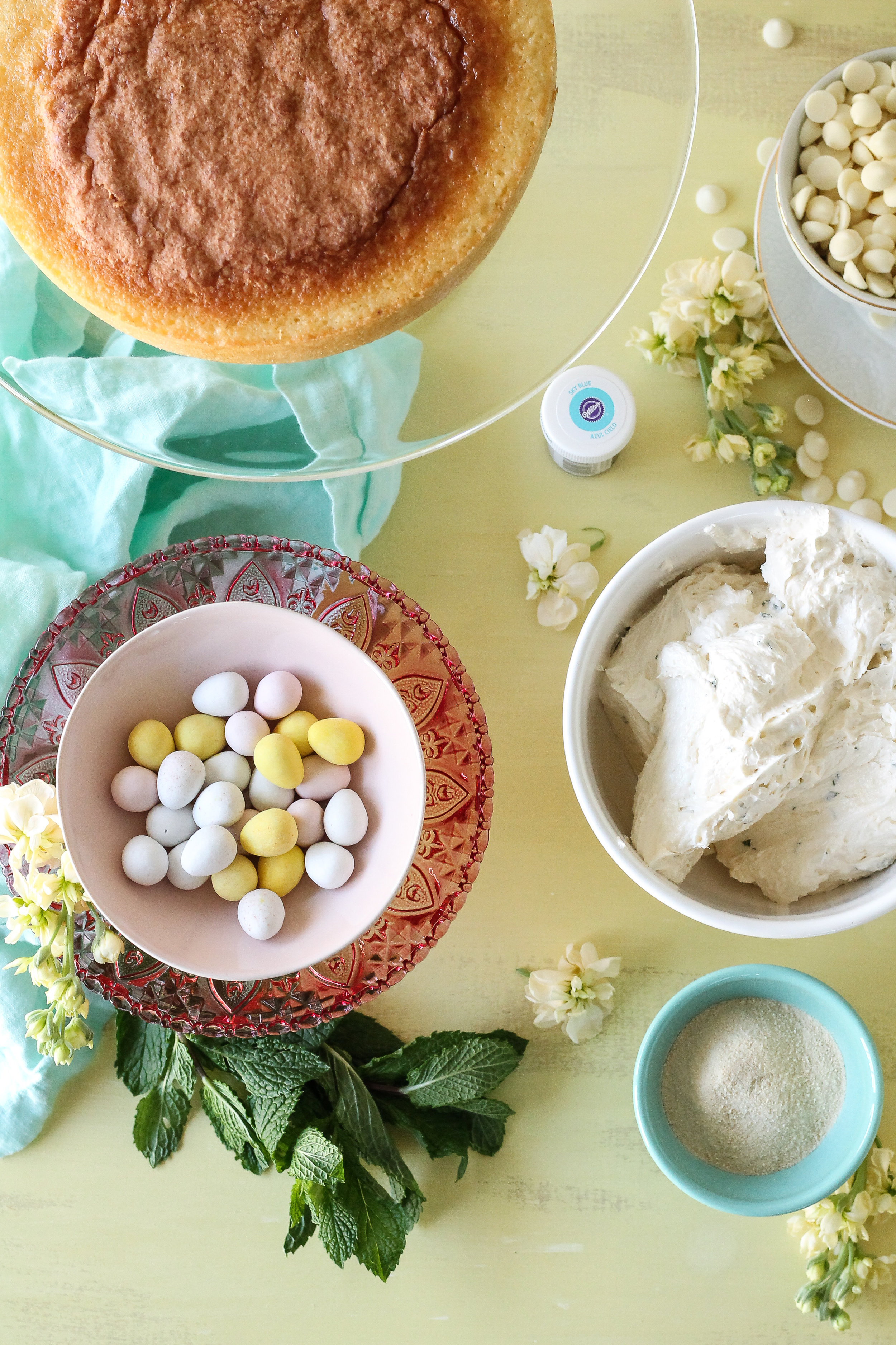 This Malted Mint White Chocolate Layer Cake has a robin's egg finish with popping blue buttercream and a caramel nest!  The perfect centerpiece for your Easter table! [ WWW.PEDANTICFOODIE.COM ]