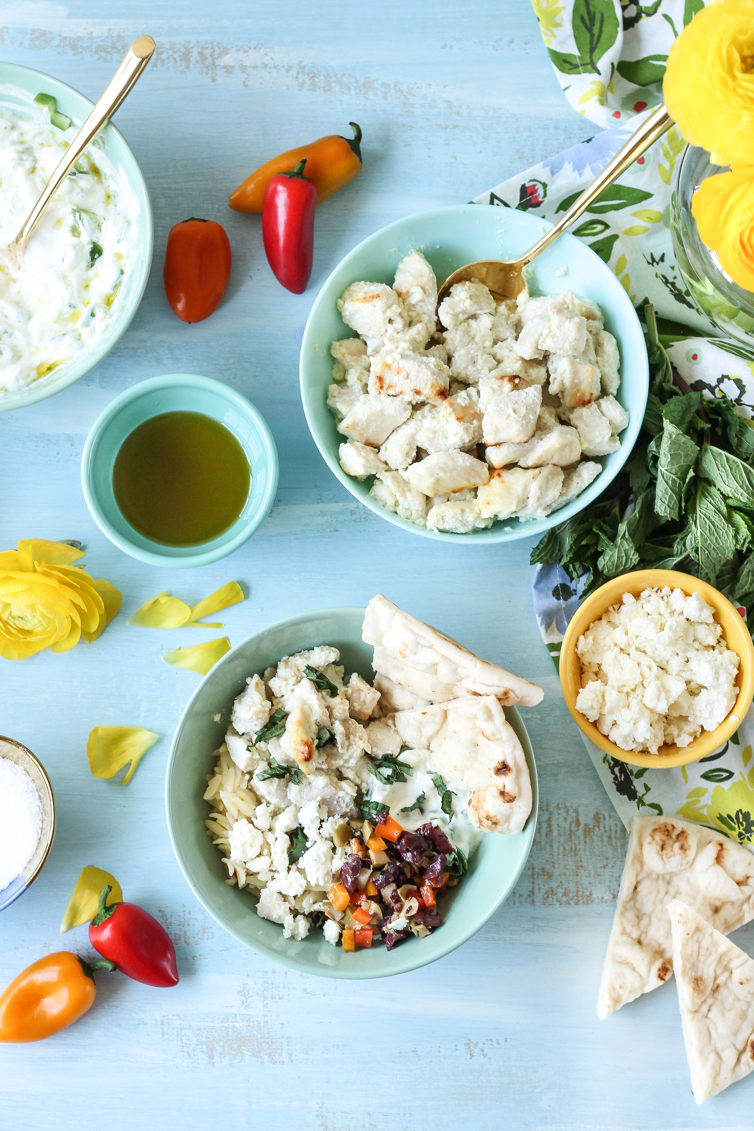 These fresh & simple Lemon & Yogurt Greek Chicken Bowls make the perfect weeknight dinner!  Find the recipe on WWW.PEDANTICFOODIE.COM.