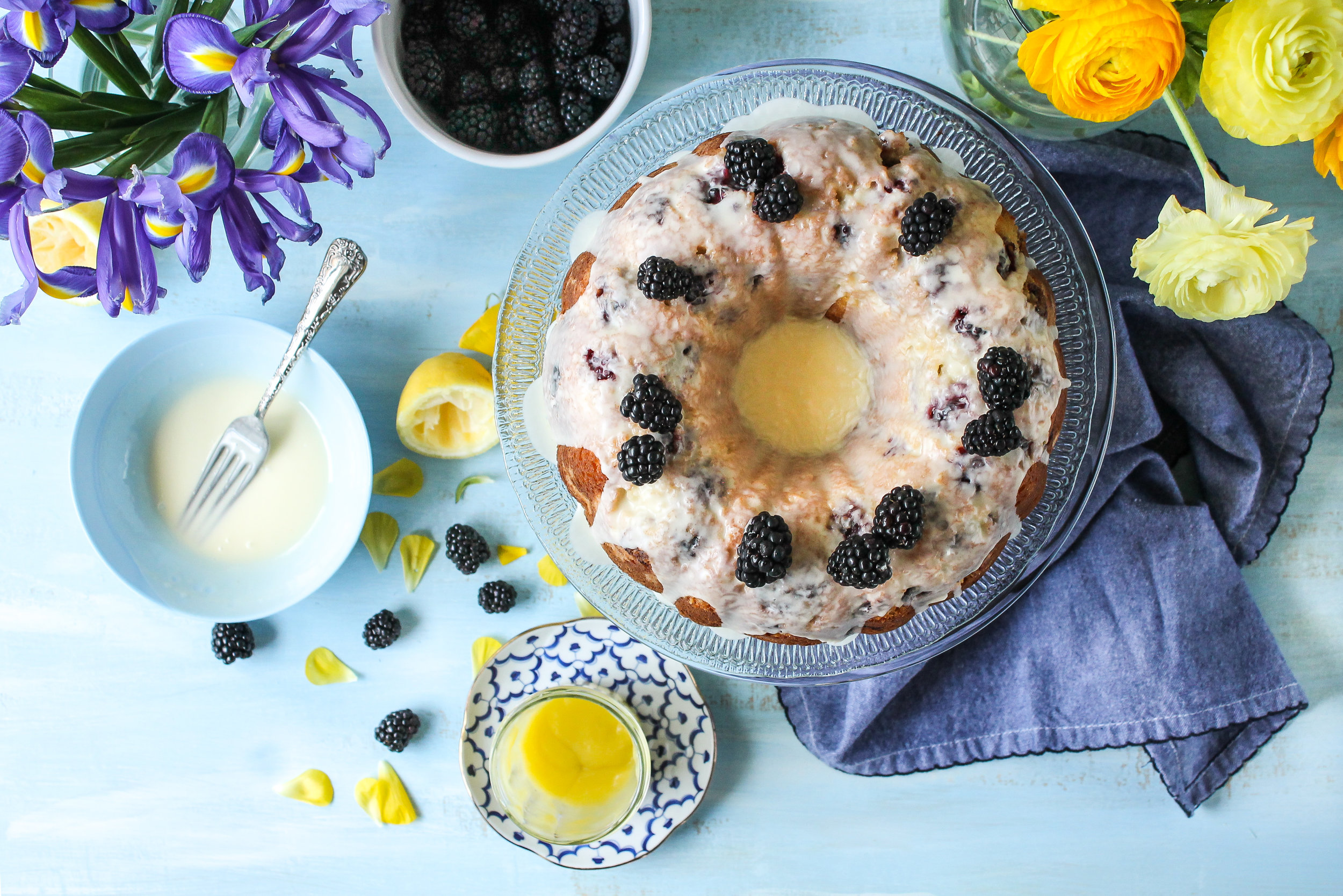 Blackberry Sour Cream Cake with Lemon Curd Glaze is the most gorgeous spring cake and is sure to be the star of any picnic! [ www.pedanticfoodie.com ]