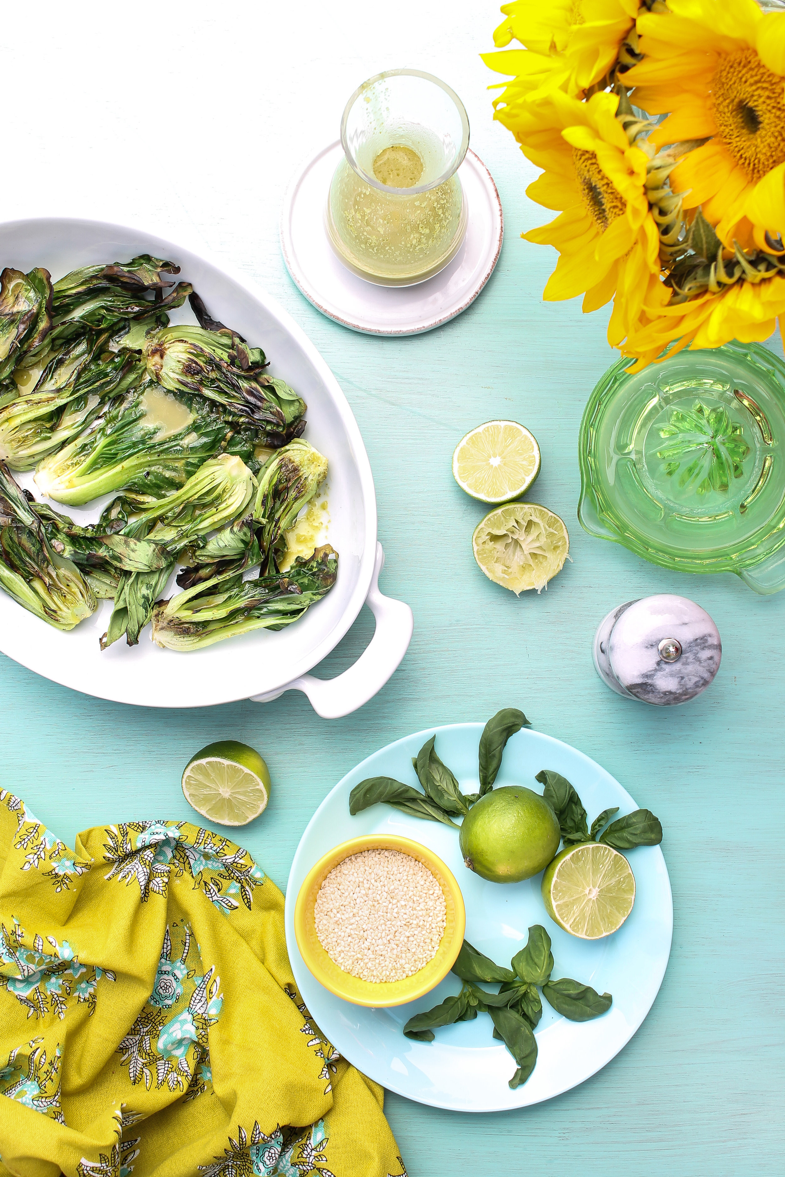 THIS SUPER EASY GRILLED BOK CHOY WITH BASIL-LIME VINAIGRETTE MAKES THE PERFECT SUMMER SIDE DISH!  Find this recipe and many more on WWW.PEDANTICFOODIE.COM.