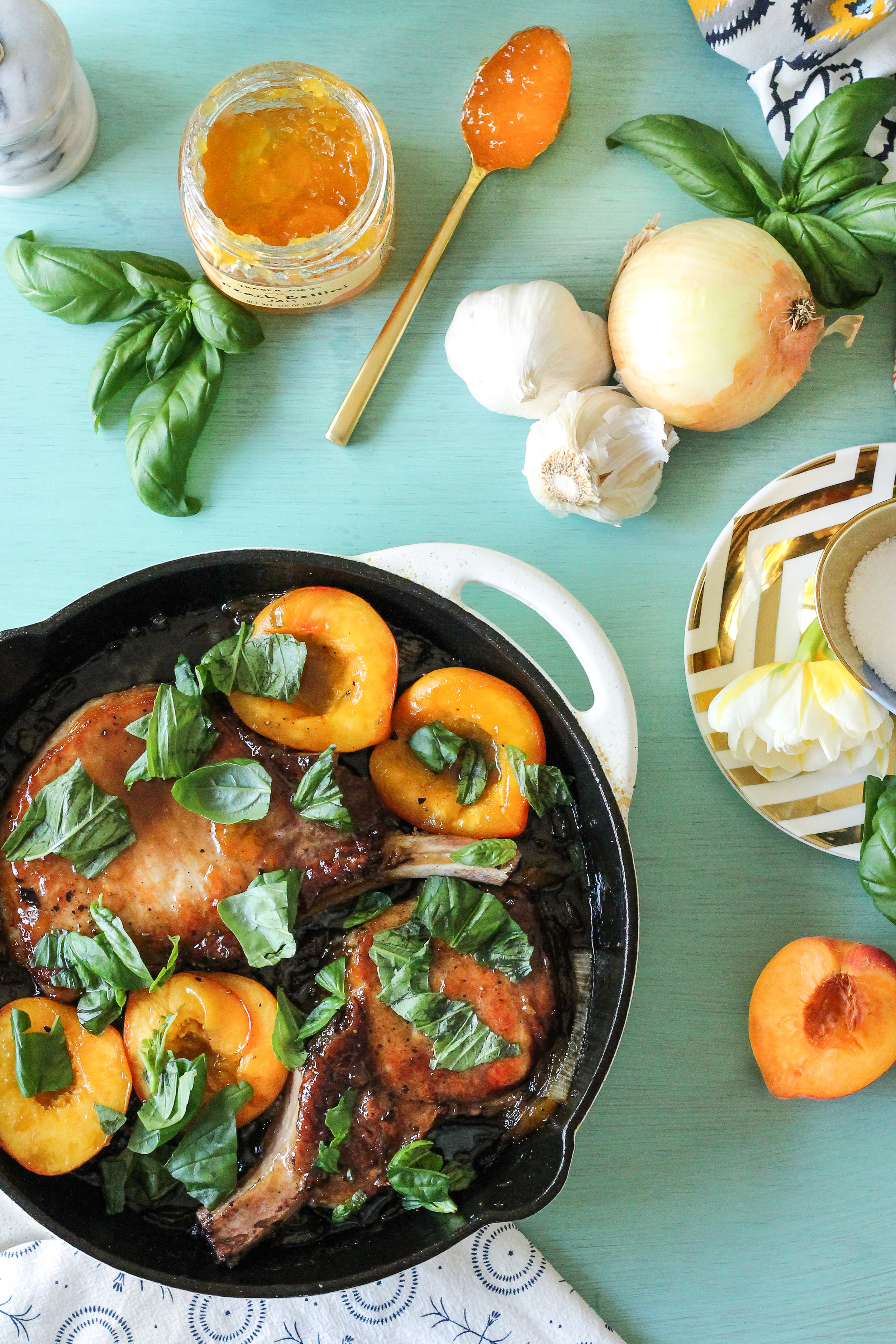 These Fresh Peach & Basil Pork Chops are the perfect sweet and savory summer dinner!  Find the recipe on www.pedanticfoodie.com!