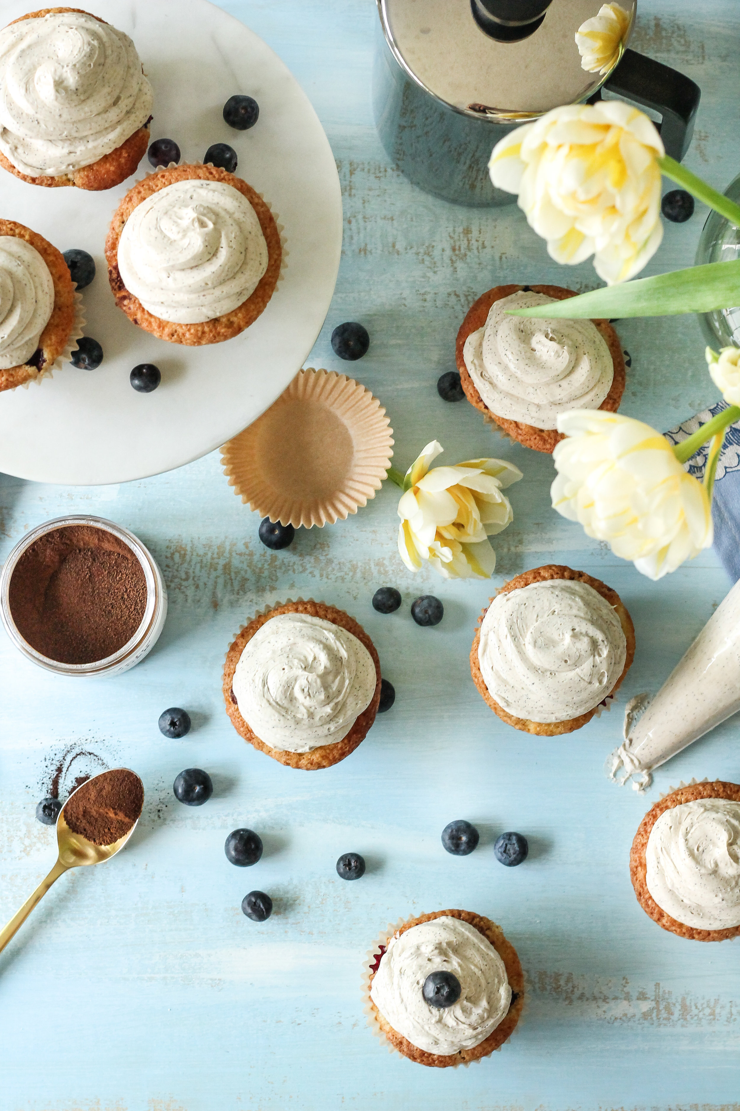 These Blueberry Coffee Cake Cupcakes with Espresso Swiss Buttercream are everyone's favorite breakfast items packed into one scrumptious cupcake!  Find the recipe on WWW.PEDANTICFOODIE.COM!