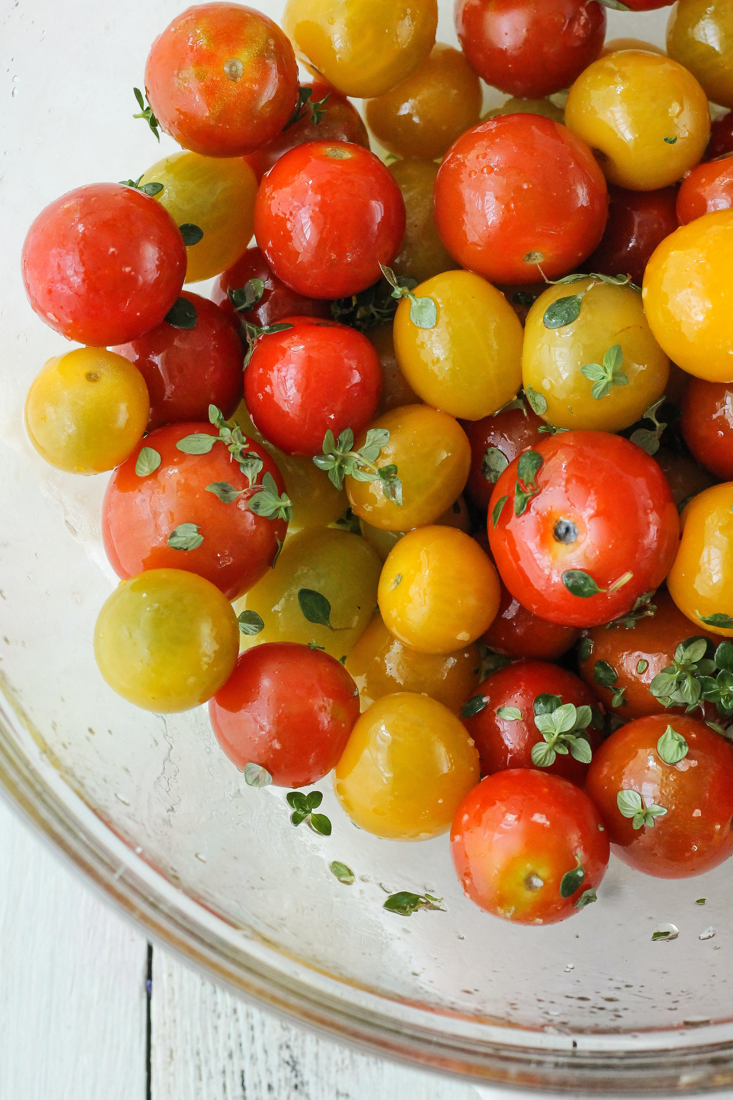 These 5-ingredient Lemon Thyme Roasted Tomatoes are one of the simplest and most delicious sides you'll make all summer!  Find the recipe on WWW.PEDANTICFOODIE.COM!