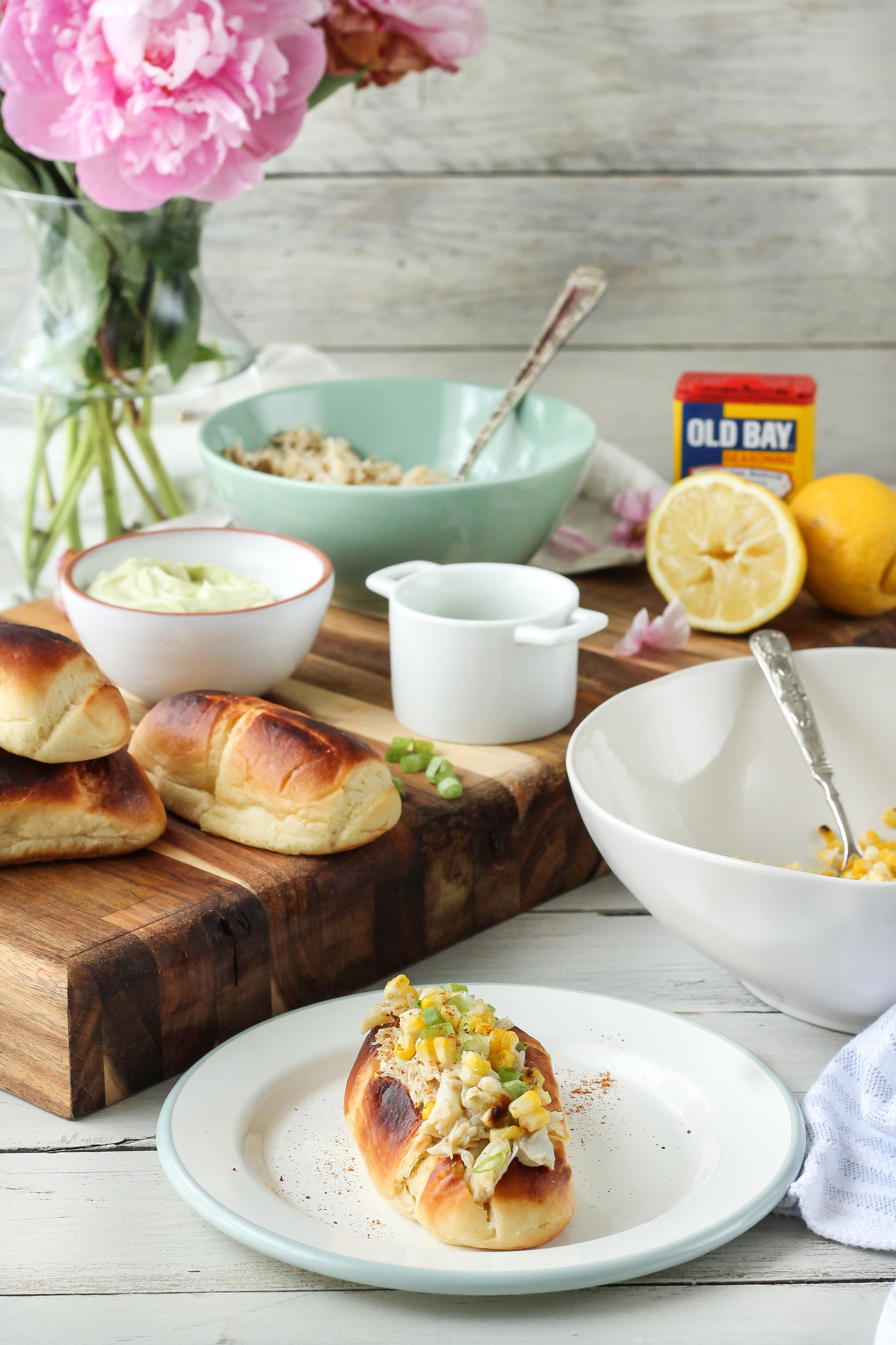 CRAB ROLLS with AVOCADO MAYONNAISE and ROASTED CORN have all the charms of a classic lobster roll but are even better!!  Find the recipe for this most perfect summer dinner on WWW.PEDANTICFOODIE.COM!