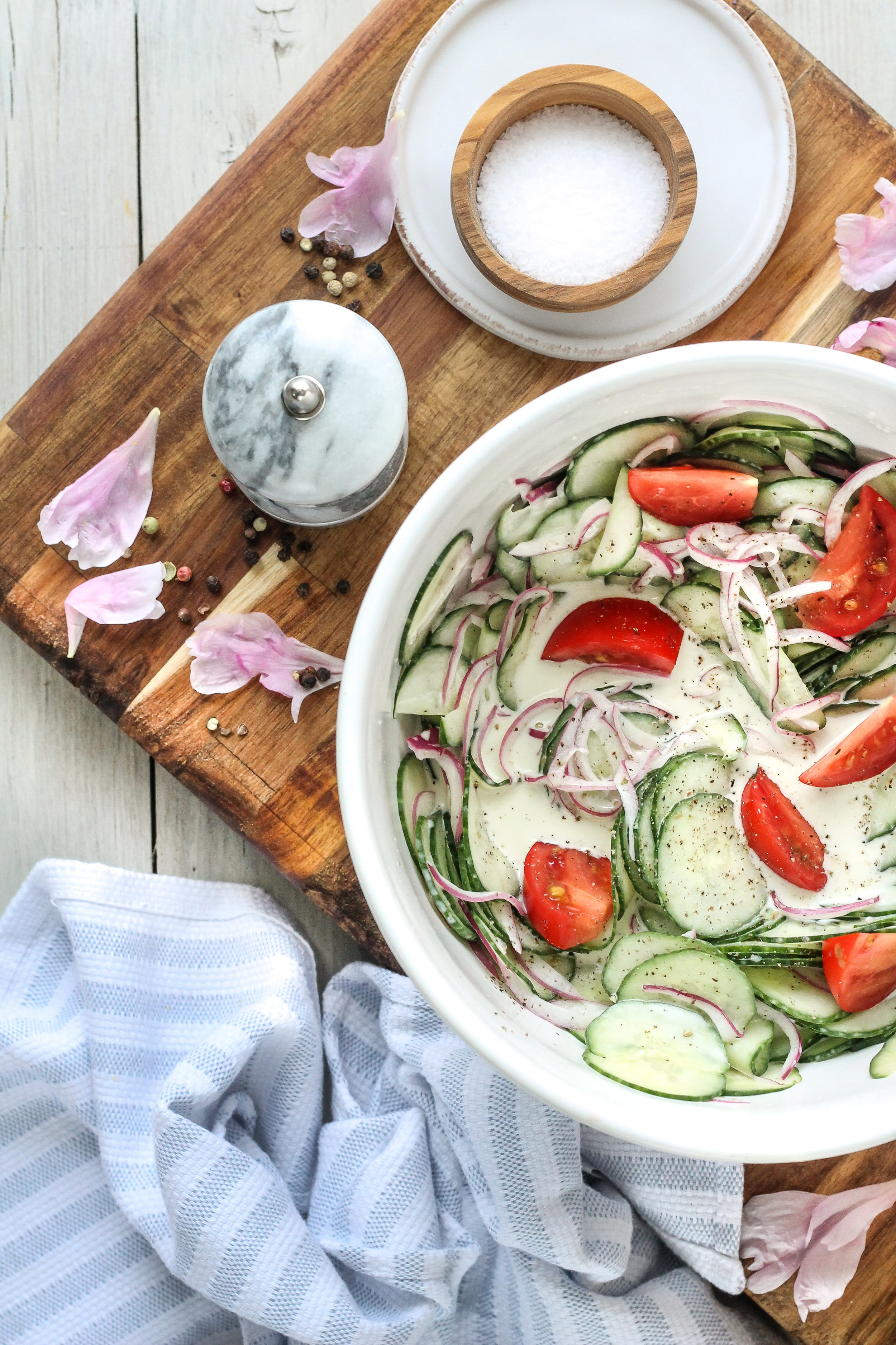 The fool-proof recipe for my family's favorite cucumber salad!  The perfect side dish for any and every summer meal!  Find the recipe on WWW.PEDANTICFOODIE.COM.