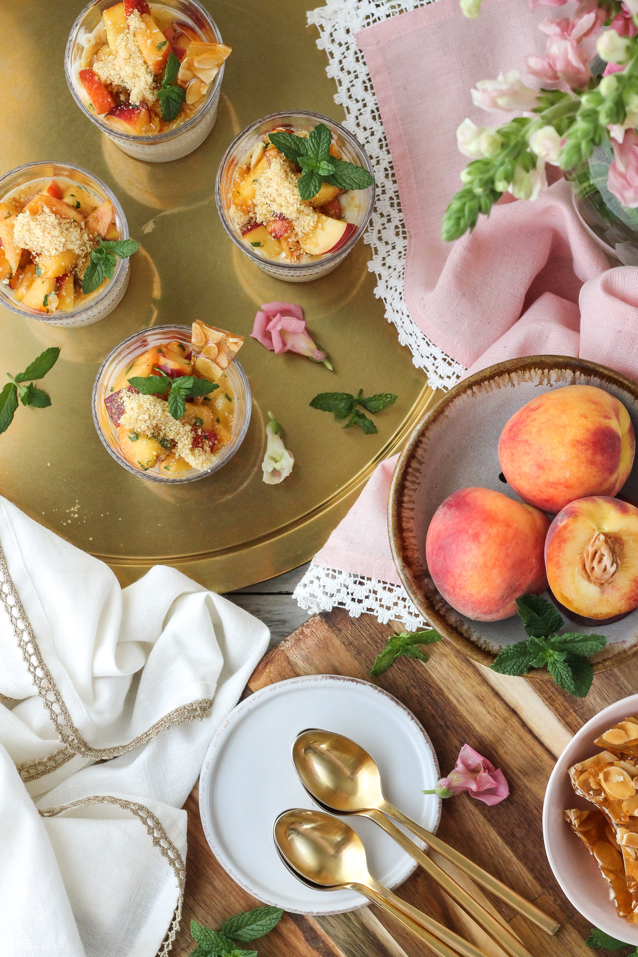 These Lemon Curd Yogurt Peach Parfaits with Almond Brittle 'Sprinkles' are one of the easiest, healthy summer desserts and they comes together in minutes!  Find the super simple recipe on WWW.PEDANTICFOODIE.COM!
