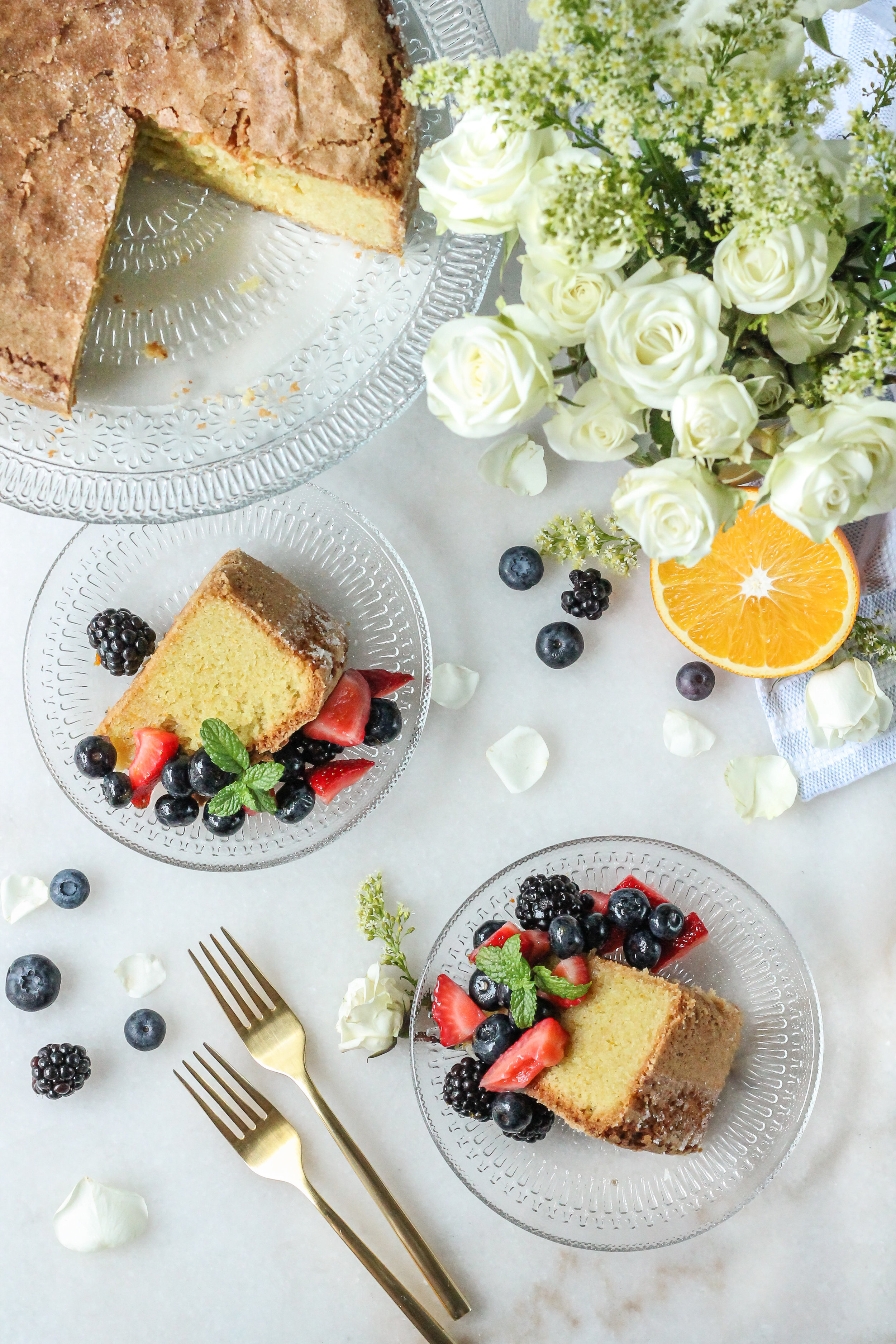 This summery olive oil cake is infused with fresh oranges and served alongside summer berries soaked in a Grand Marnier syrup!  Find the recipe for this amazing dessert and many more on WWW.PEDANTICFOODIE.COM!