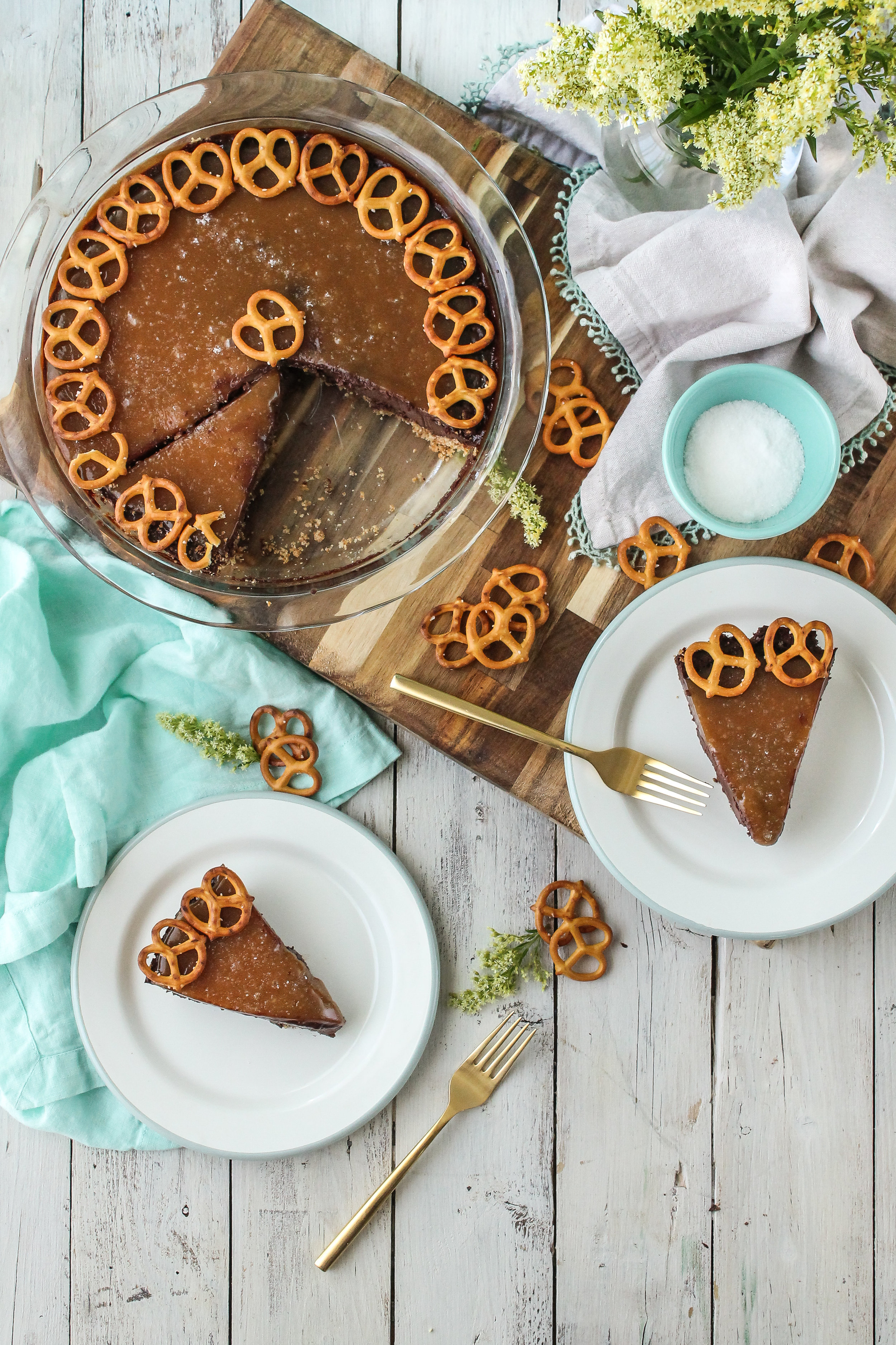This sweet and salty Gluten-Free Salted Carmel Dark Chocolate Pie has a crunchy gluten-free pretzel crust and the most decadent chocolate custard.  Find this recipe and so many more on WWW.PEDANTICFOODIE.COM
