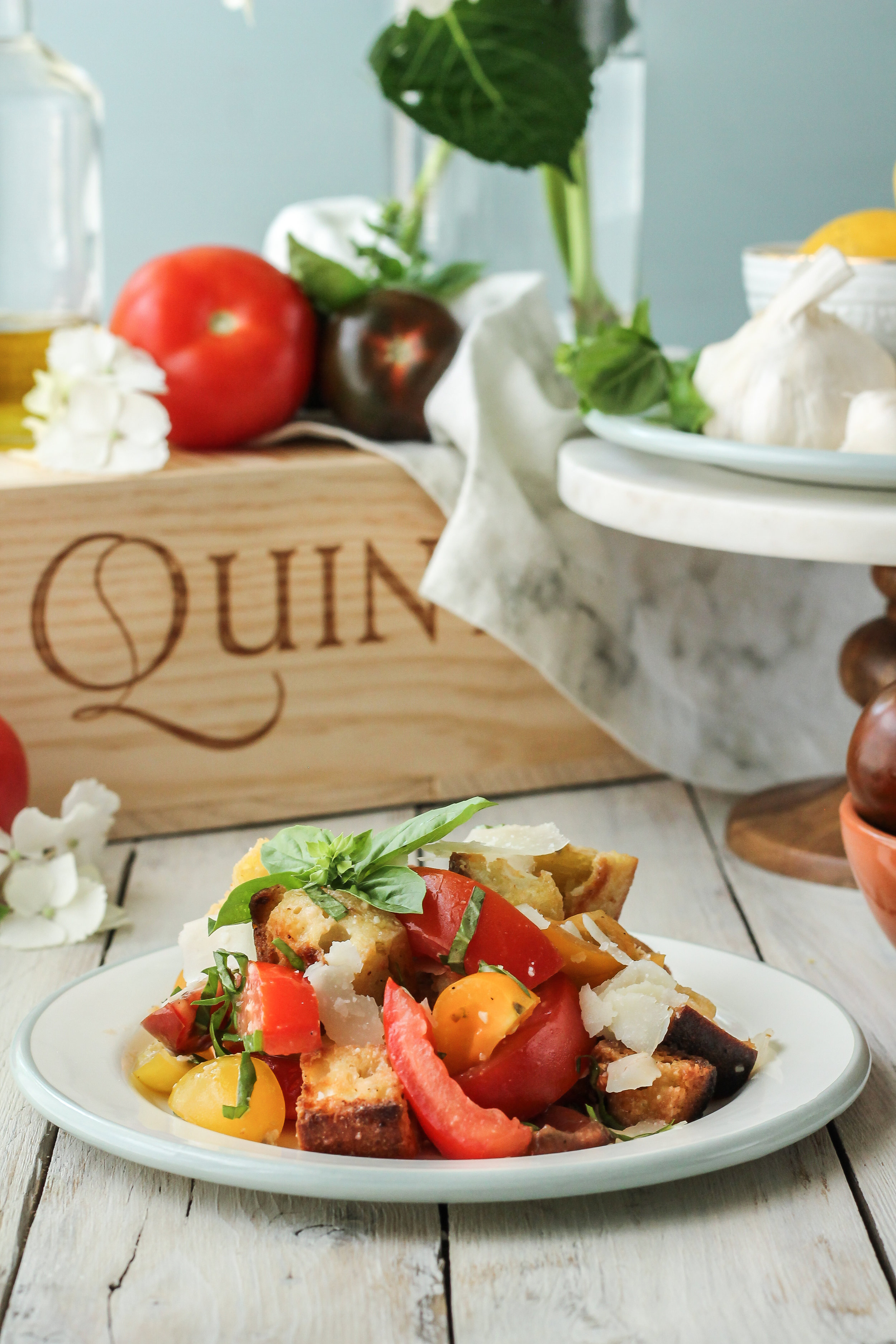 This bruschetta panzanella salad is the perfect summer side dish that comes together in minutes!  Find this recipe and so many more at www.pedanticfoodie.com!