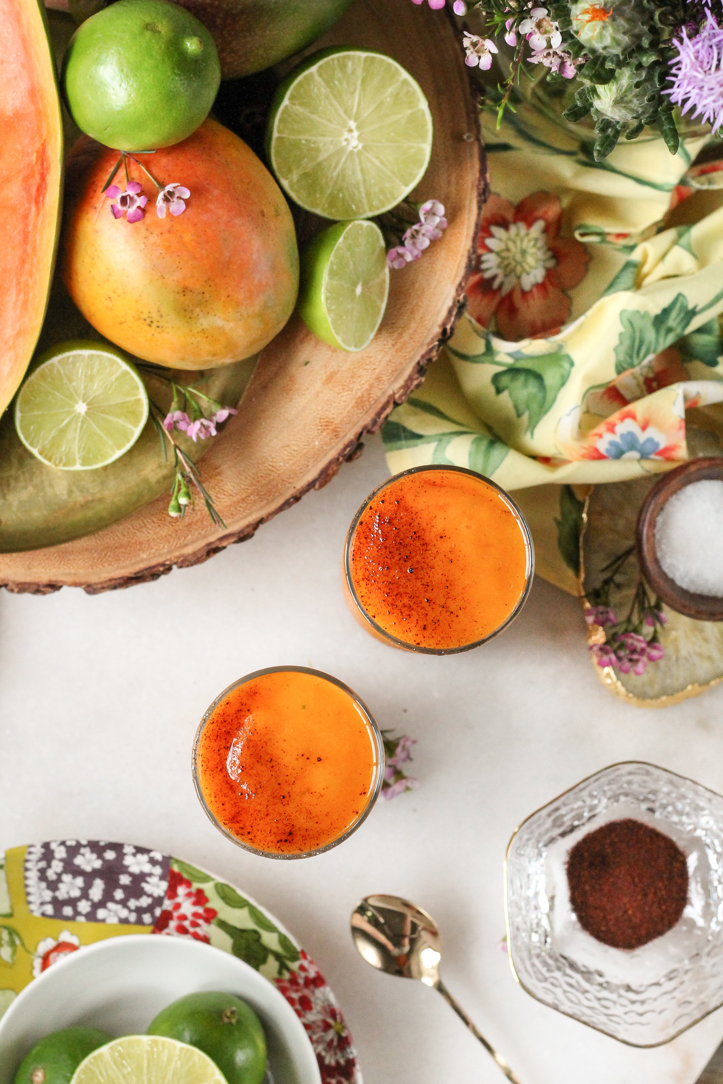 These sweet and spicy Salted Lime & Chili Mango Papaya Slushies are unexpected and refreshing!  The perfect way to cool off this summer!  Recipe from WWW.PEDANTICFOODIE.COM.