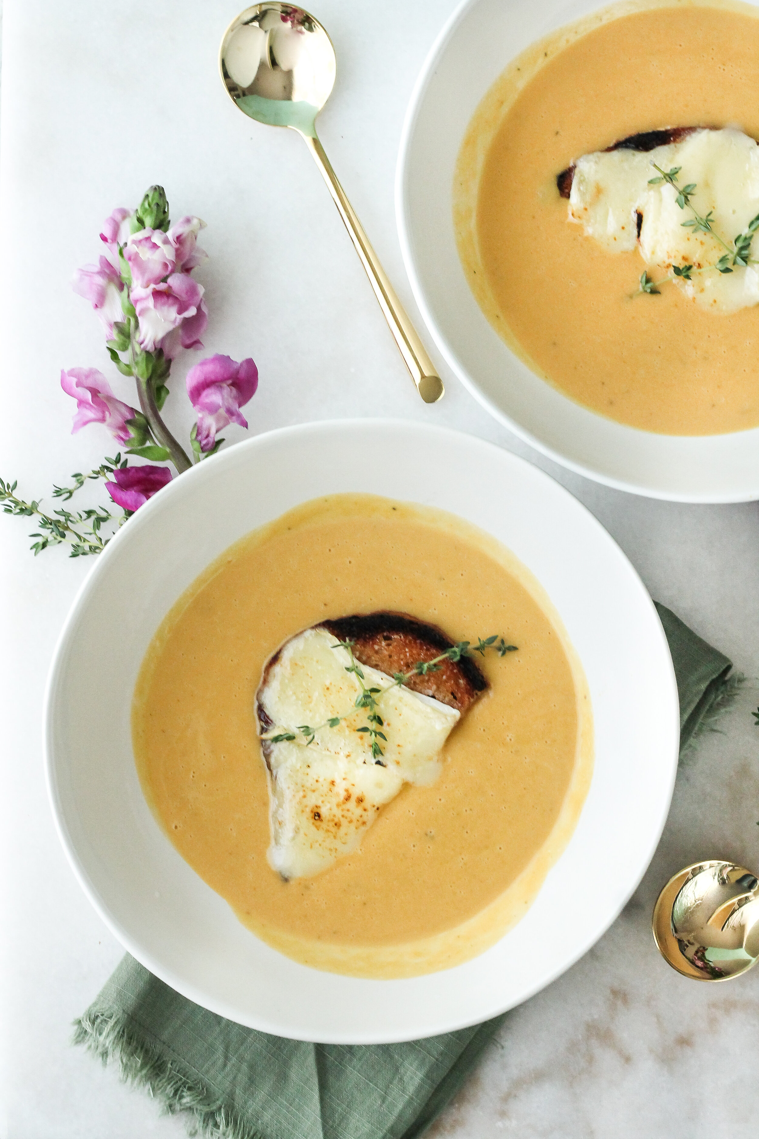 Butternut squash soup is stepped up a notch with maple butter brie crostini!  Find the super simple recipe on www.pedanticfoodie.com!