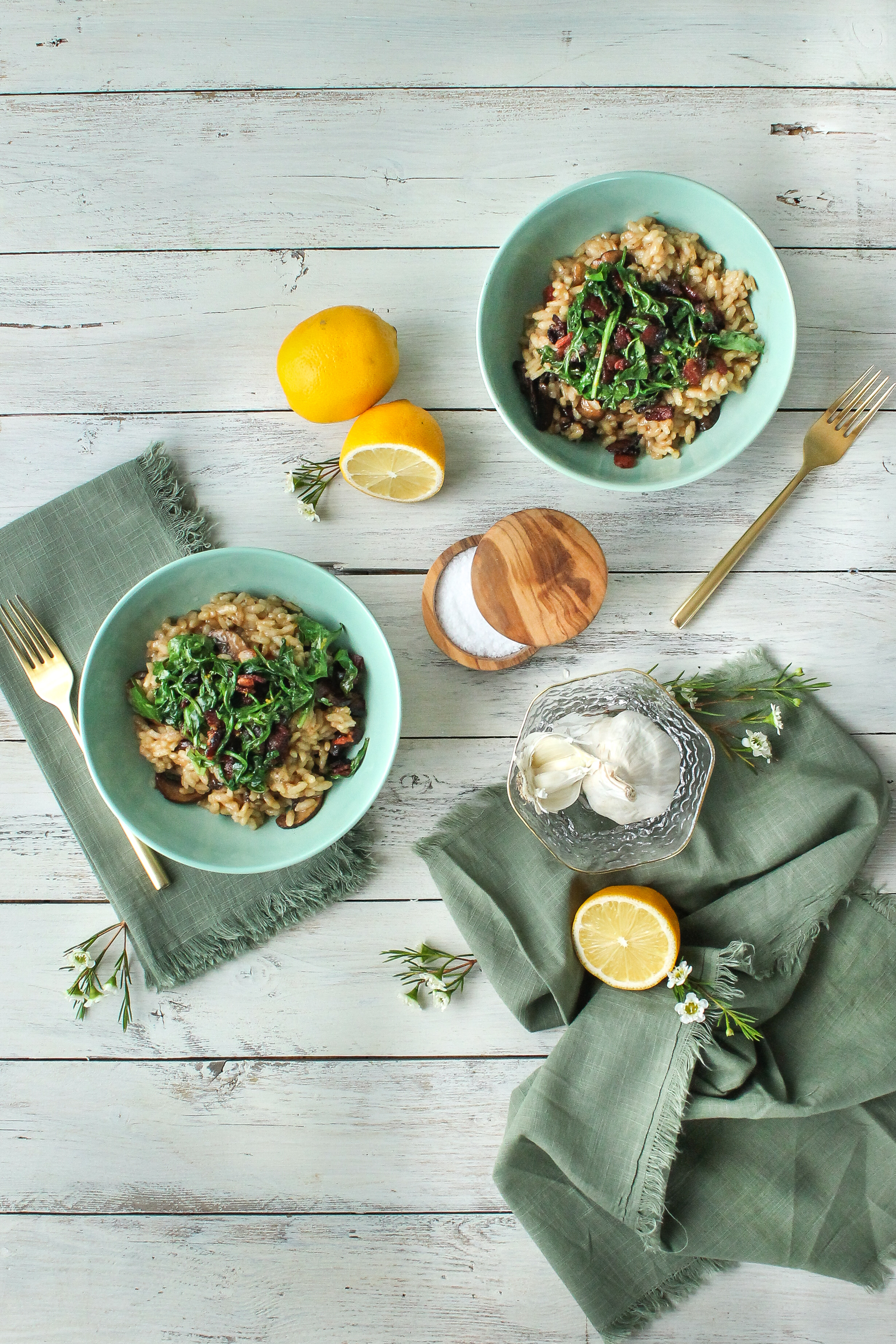 The perfect cozy night at home!  This mushroom & parmesan risotto with bacon and arugula is quick and easy to make and the perfect comfort food.  Find this recipe and so many more on www.pedanticfoodie.com.