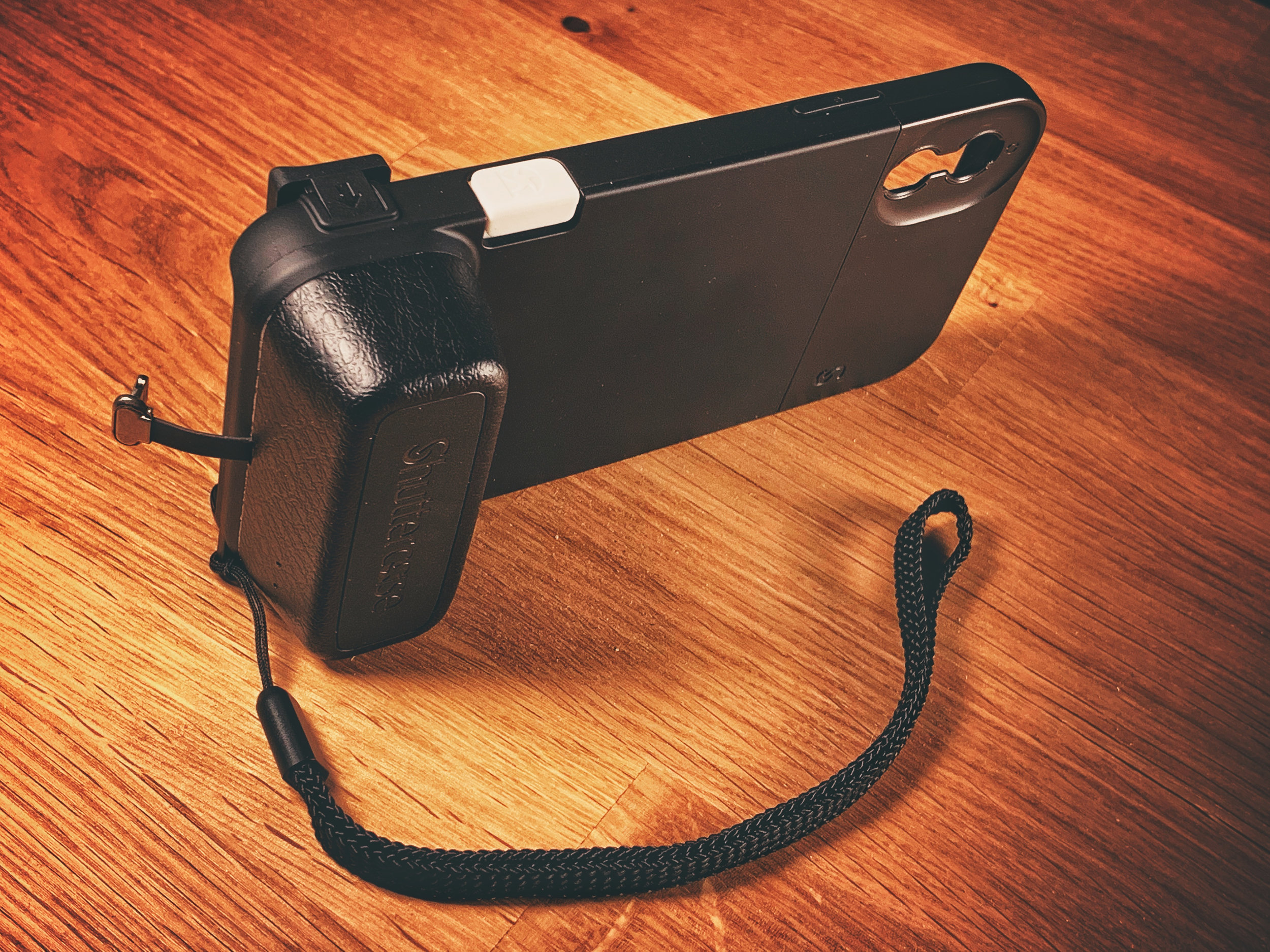 The Shuttercase features a battery grip, thumb grip, and a very convenient shutter button.