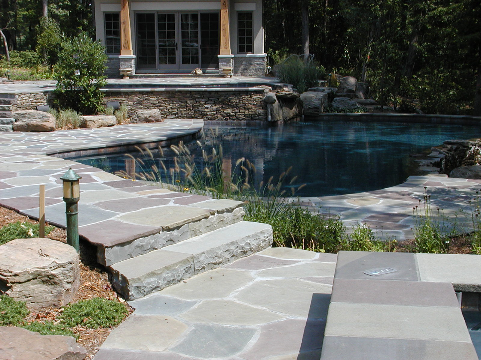 Full color Irregular flagstone pool deck with custom coping.
