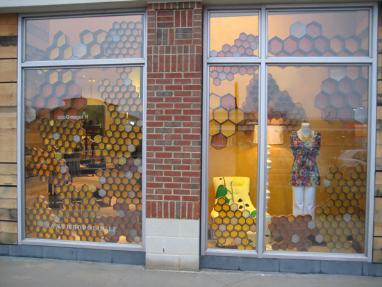 This was a very labor-intensive set of windows as each honeycomb was  individually made using double-walled cardboard and tissue and wax  paper. I then glued them together to create clusters. As you can see, I  made the honeycomb in two different sizes and a variety of colors  ranging from brown to amber to yellow.