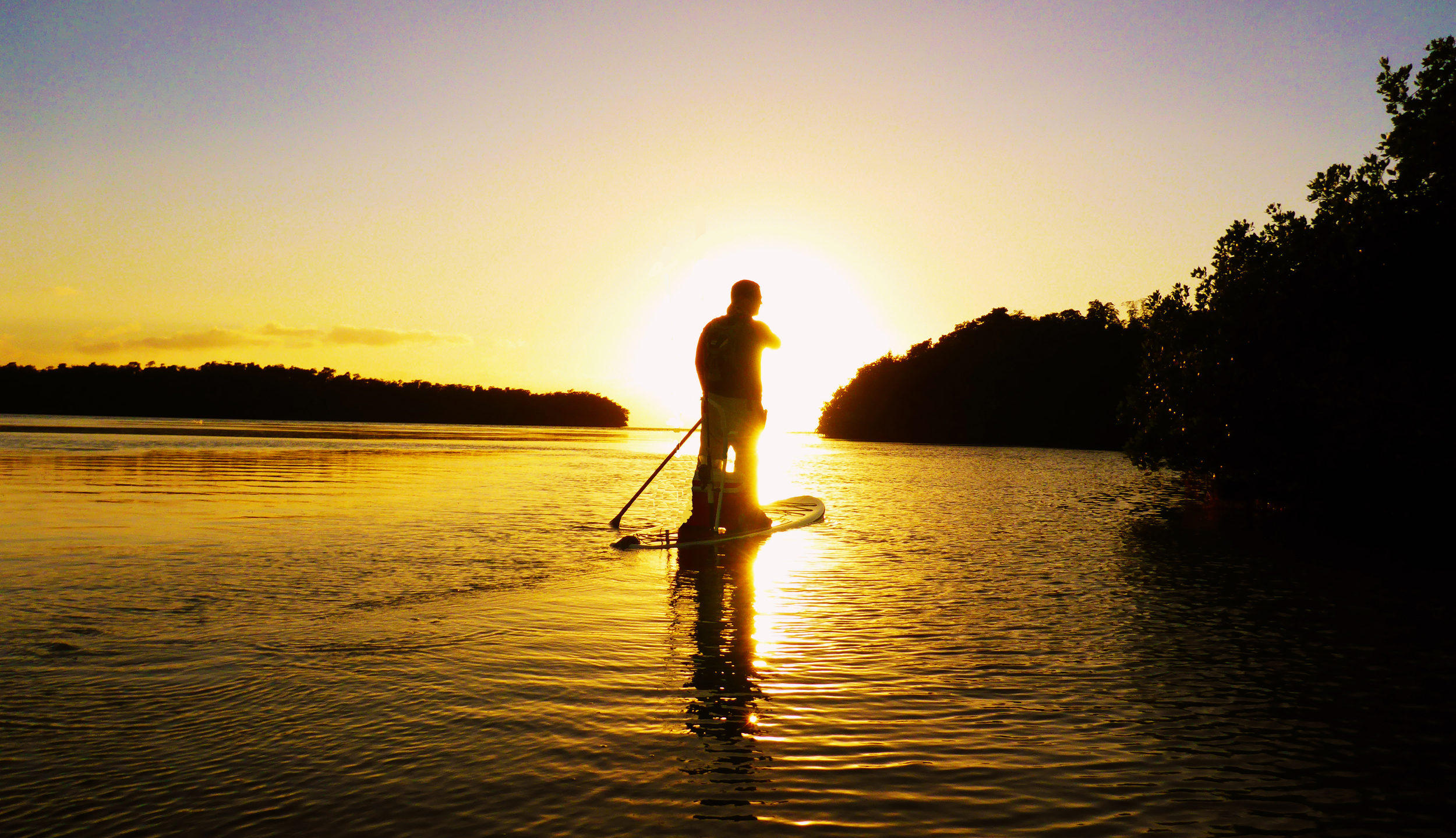 Trey Dyer enjoying a beautiful Florida sunset from atop his paddleboard