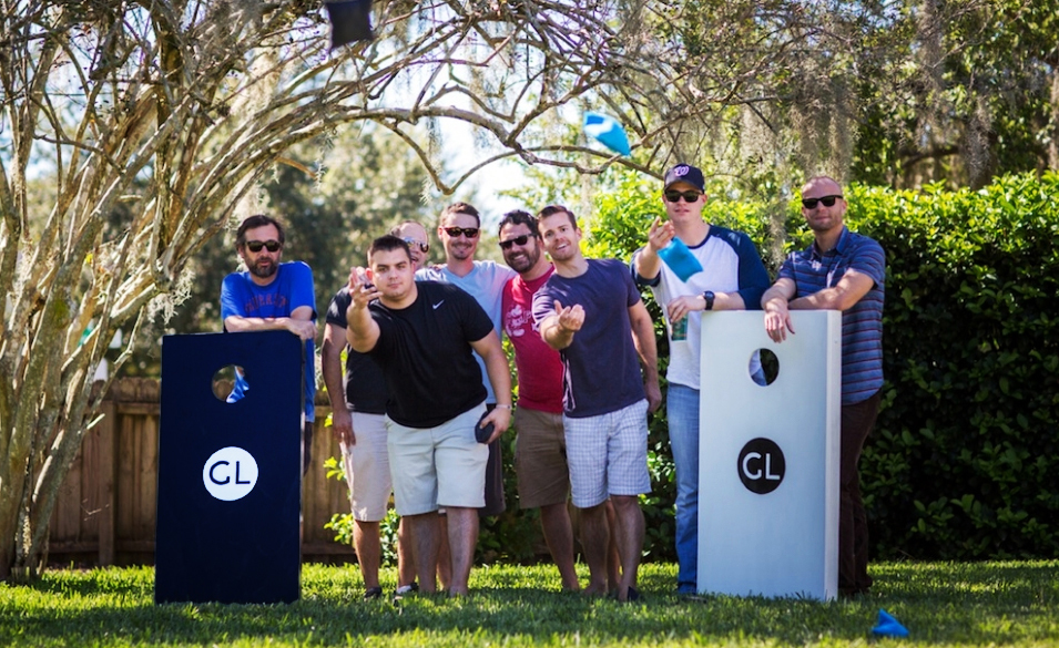 Get Local and friends enjoying a little afternoon cornhole in Orlando