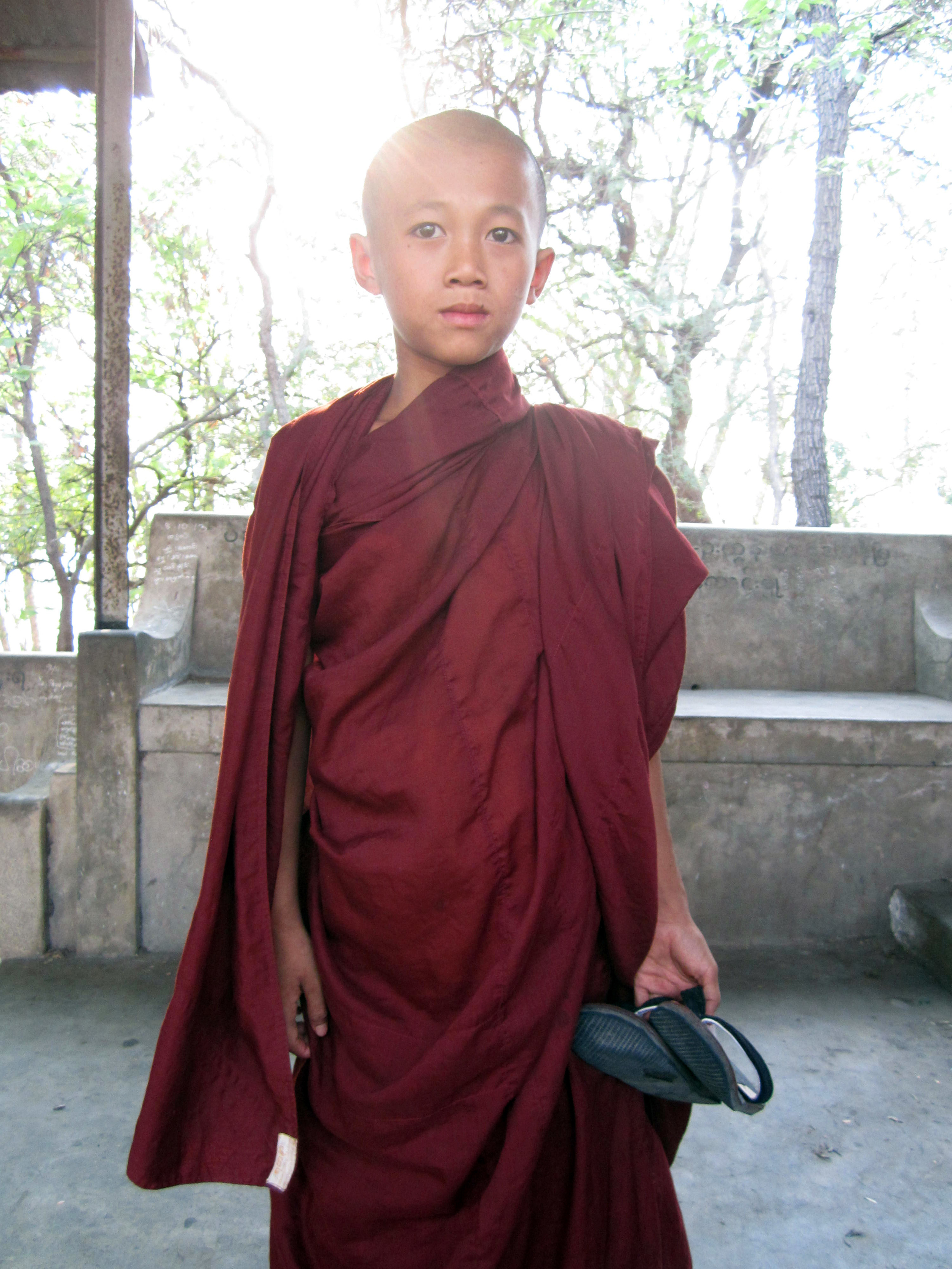 An intrigued monk I came across while hiking up Mandalay Hill in Myanmar
