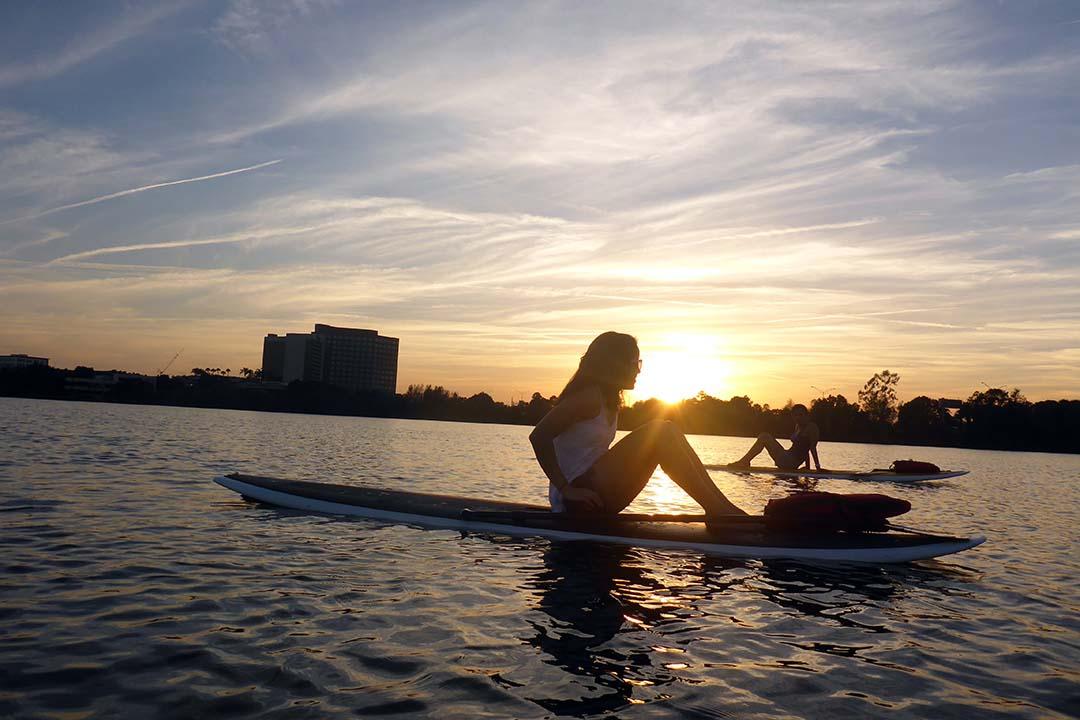 Girls paddleboarding at sunset.jpg