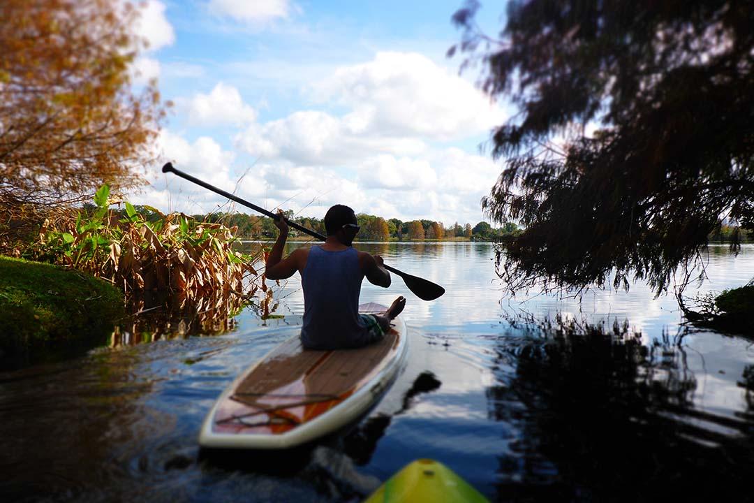 Sit down paddleboarding on lake ivanhoe.jpg