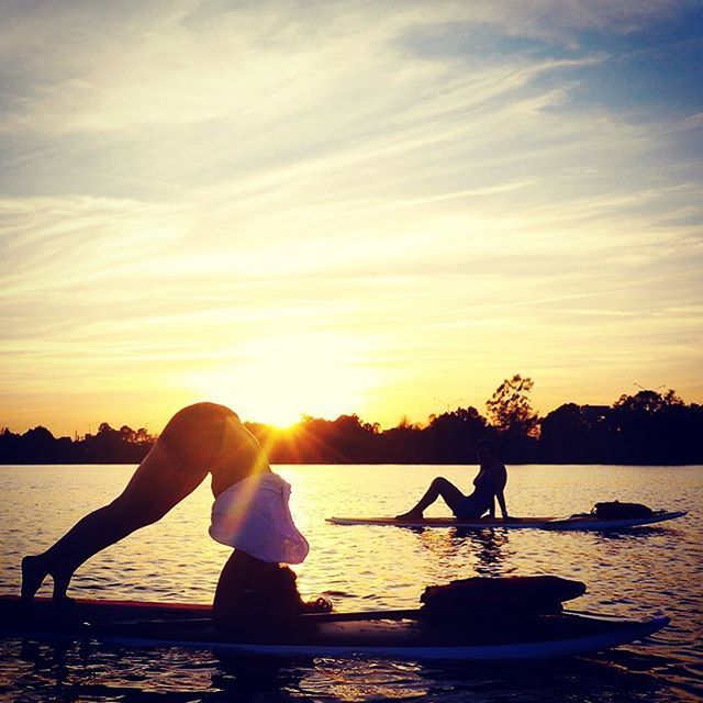 If you haven't ridden a SUP at sunset you're missing out. Come hang. #chillvibes #paddleboarding #getlocal #orlando #paddleboardyoga