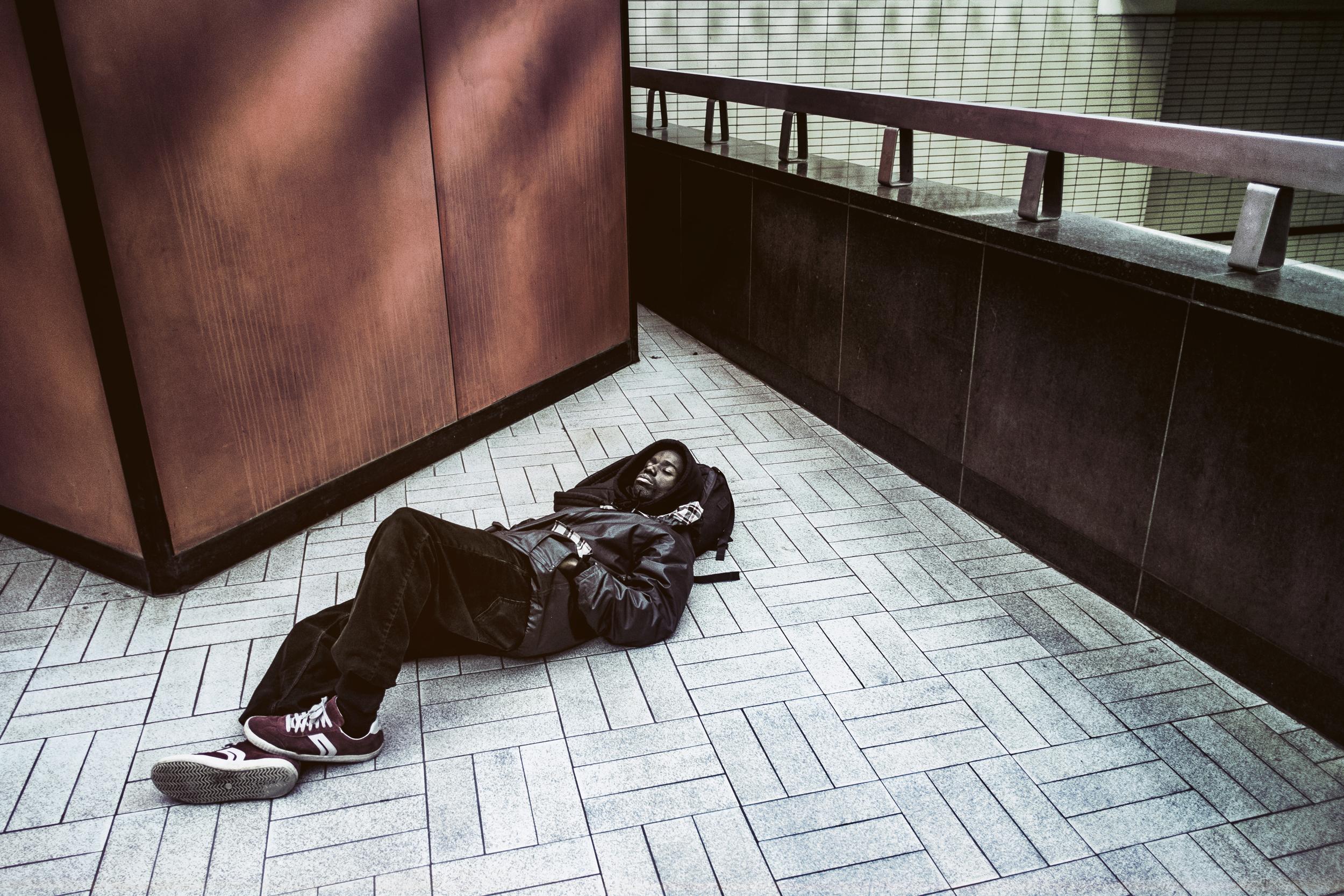 A man sleeping inside Sherbrooke Metro, Montréal,Québec.