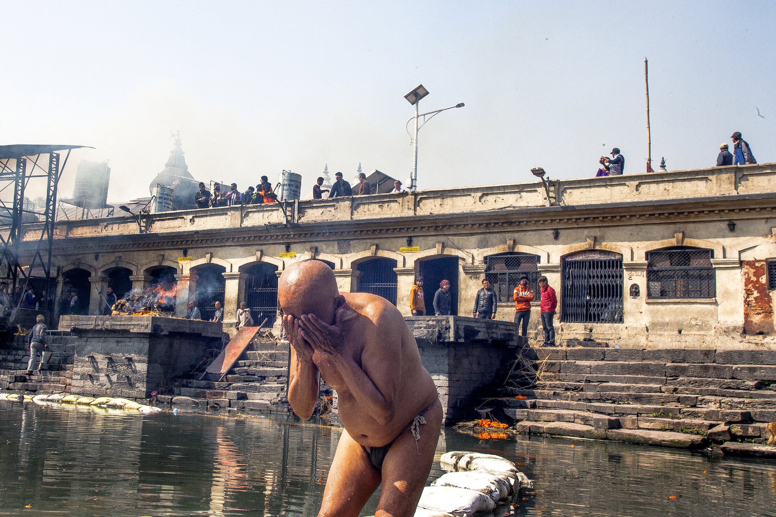 A man washes in the Bagmati River after Tonsure.