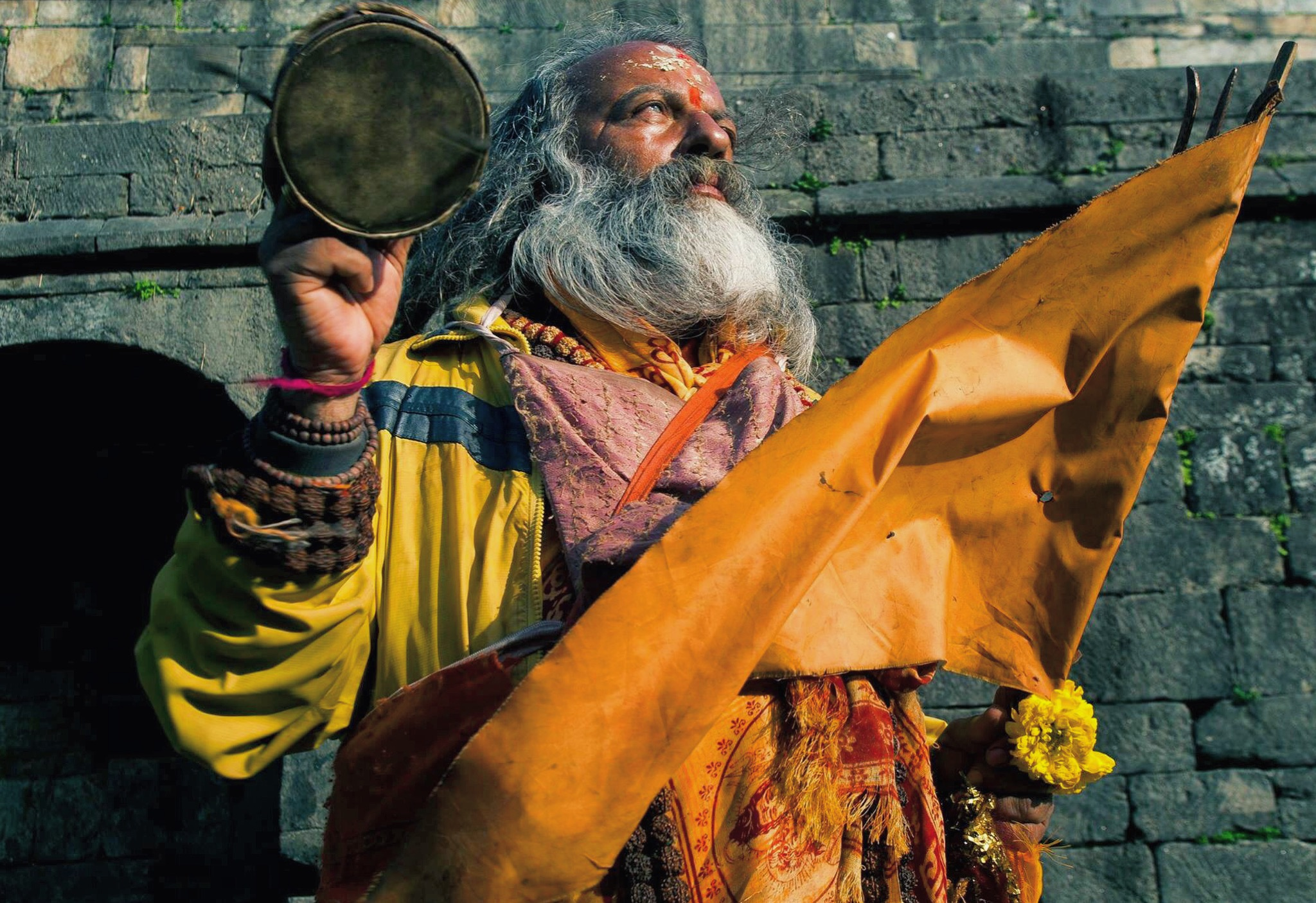 A sadhu, or holy man, originally from England prays in the setting sun on Pashupatinath's western bank.